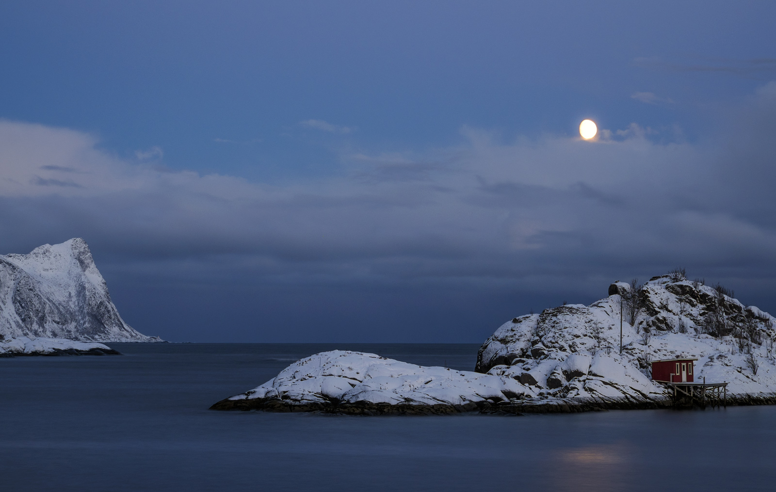 Moon set over Hamn i Senja, and the delicious snow covered islands surrounding this tiny hamlet.  The water was quite still...
