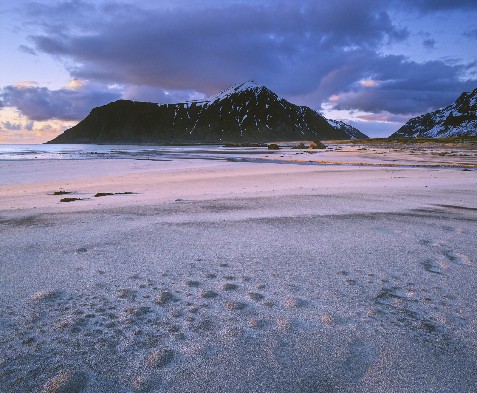 An underground river running off the ridiculously jagged peaks that make up 90% of the Lofoten islands bubbles underneath the...