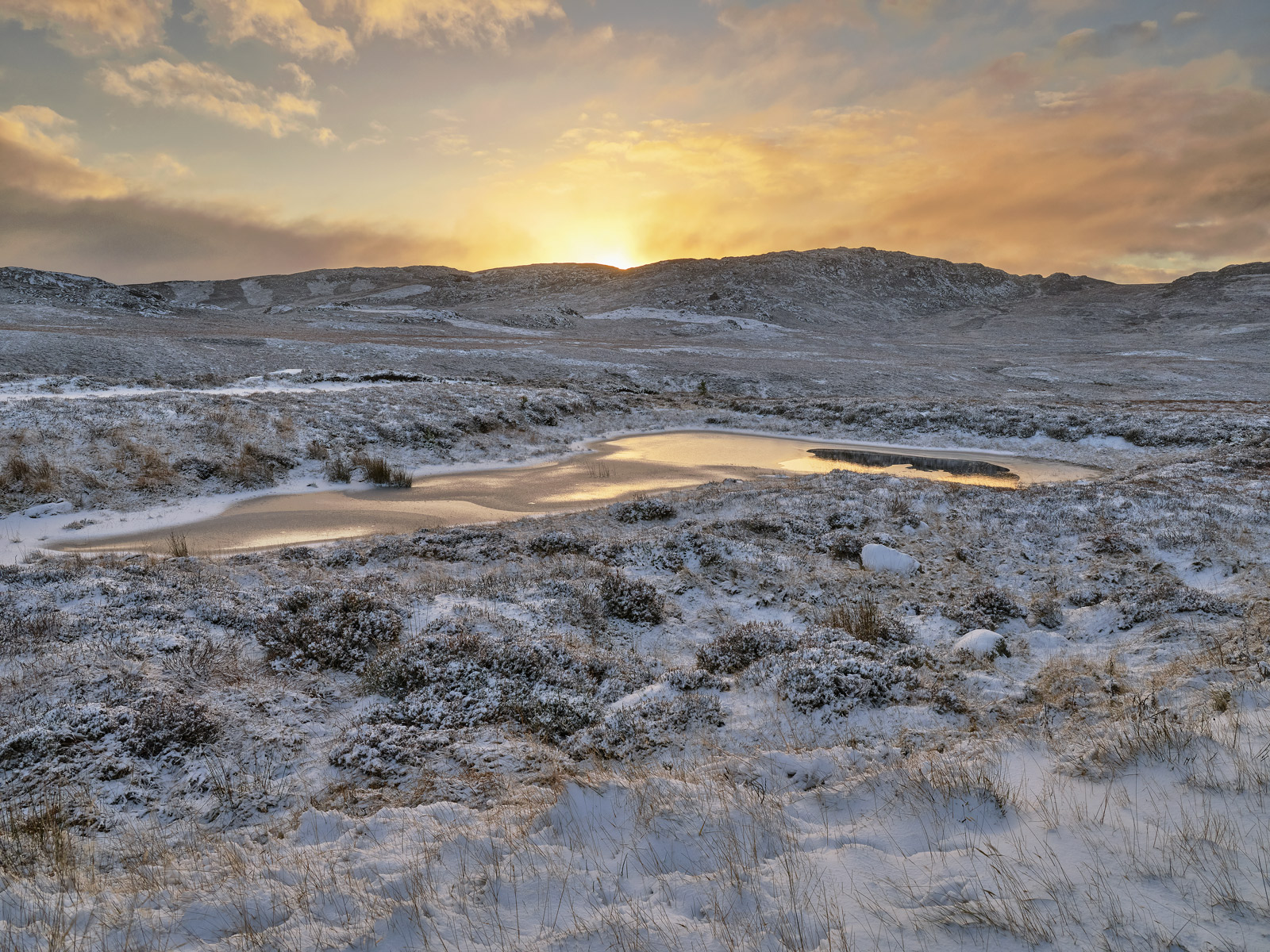 I was very keen to capture the very first moment that the sunrise crested the top of the snow dusted peak at the summit top of...