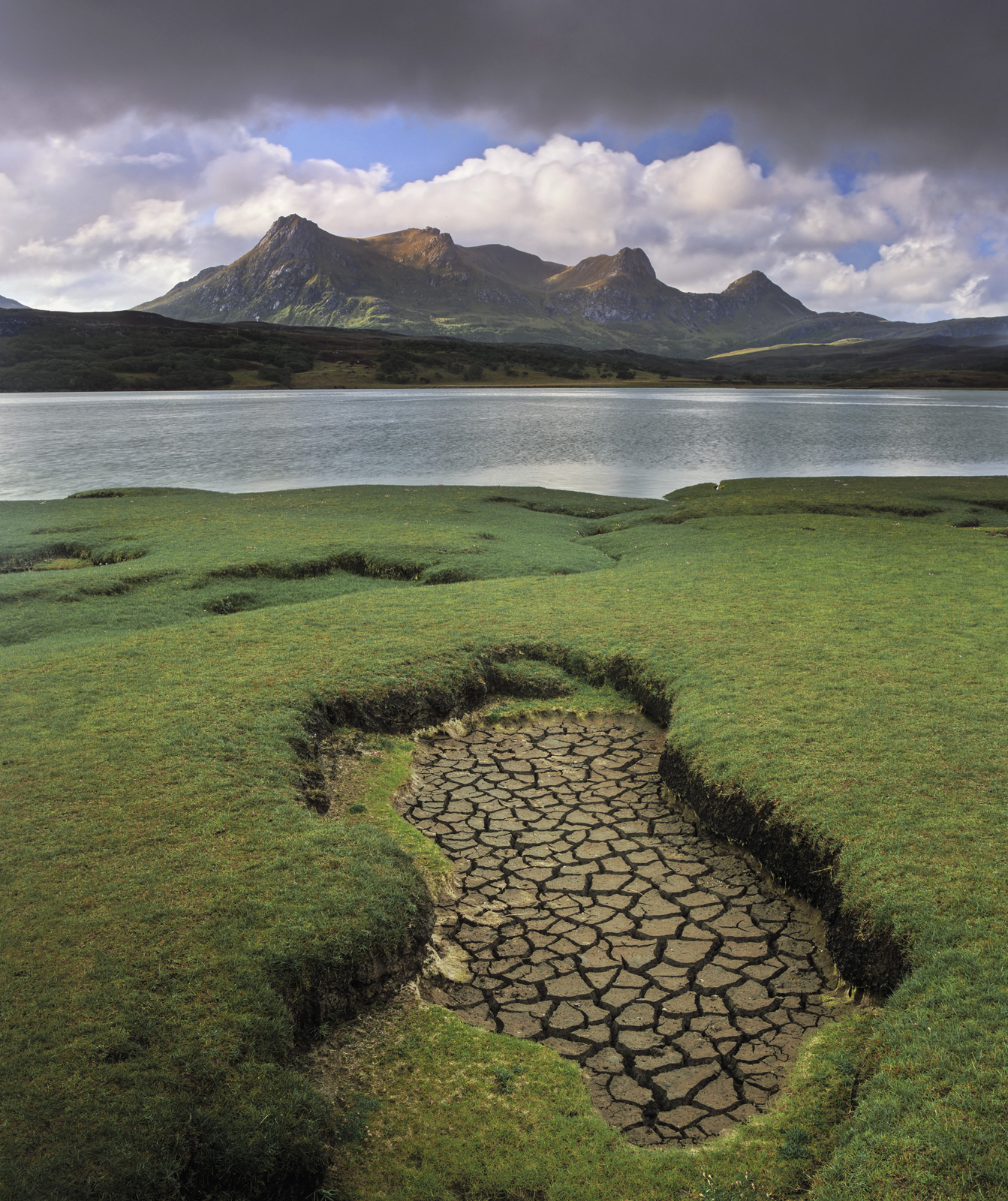 A summer squall builds over the shapely peak of Ben Loyal across the Kyle of Tongue. It would appear that the water is...