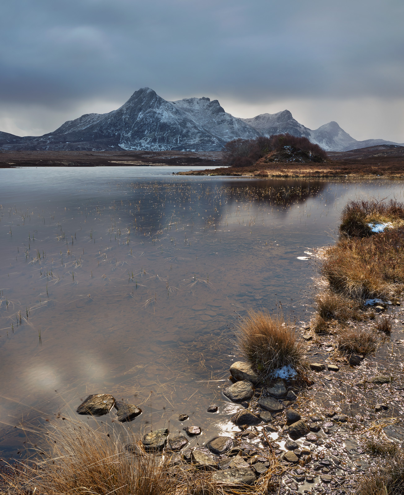 A passing deluge of snow and hail marches onward to Ben Loyal before reverting back to brilliant sunshine as it paints the immediate foreshore.