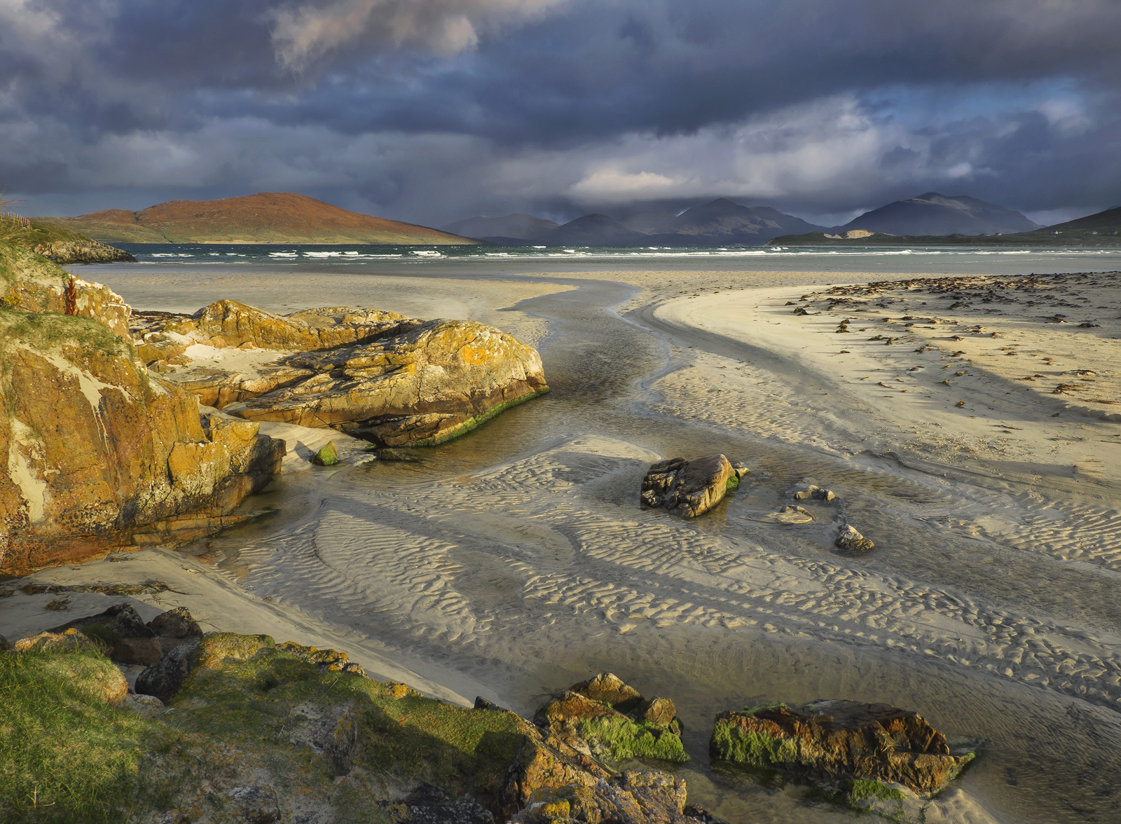 Gorgeous low angled golden sunlight raked it's way beneath low clouds and painted the spectacular Harris coast with the most...