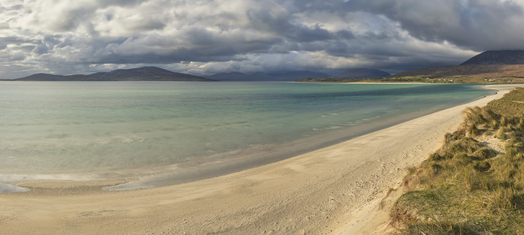 A panoramic view of Seilebost's immense and pristine sand beach at Luskentyre bay on the Isle of Harris.