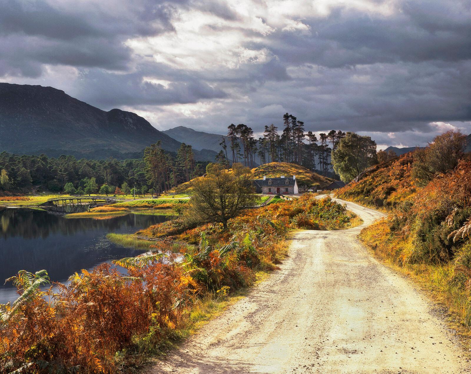 Everything in this glorious Highland scene seems to organise itself perfectly.  The winding road meanders left and right to the...