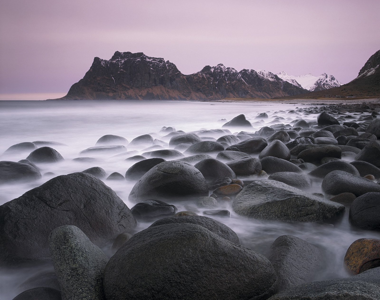 Extremely rough seas, high freezing winds and a stormy sky greeted us on our visit to Lofoten's magnificent boulder beach at...