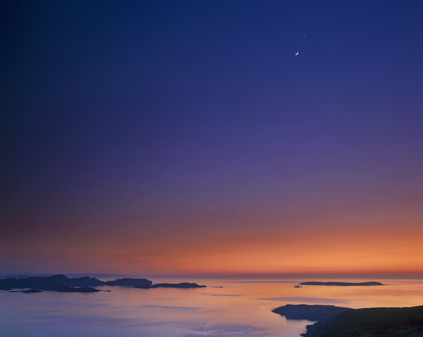 A stunning sunset over Polbain on the coast of Inverpolly overlooking the Summer Isles slowly melted away. Despite the...
