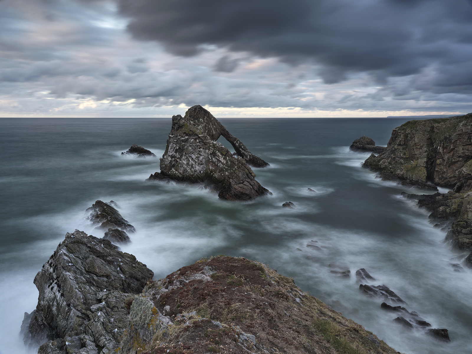 This is quite possibly the moodiest I have ever seen the Bowfiddle Rock and bizarrely it was taken in the middle of Summer on...