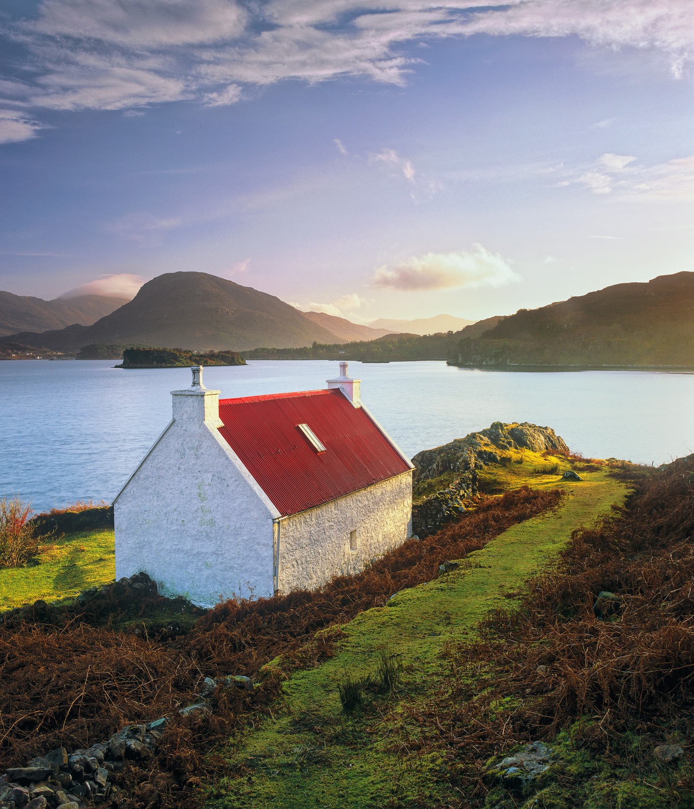 This wee red roofed white cottage on the shoreline of Upper Loch Torridon is set in the most beautiful place close to the tiny...