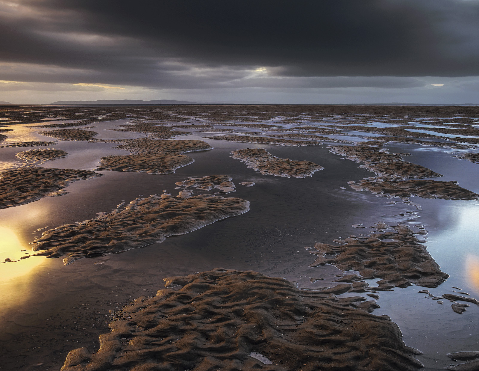 At low tide Findhorn is a pretty expansive beach and it is a fair old walk down to the sea. The river Findhorn flows out...
