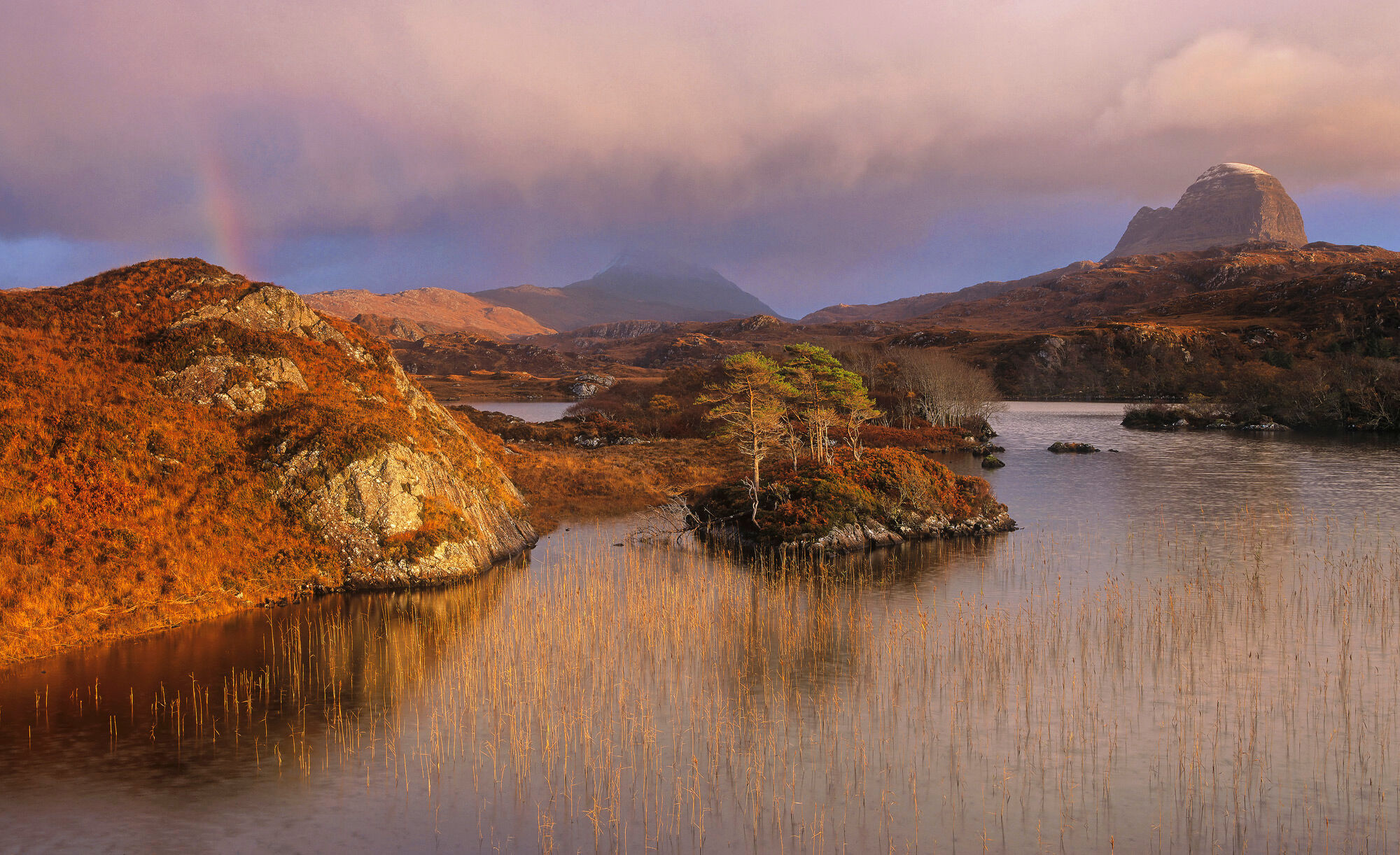 Astonishingly beautiful golden light found a way to escape the low hanging clouds over Loch Druim Suardalain near Loch Inver...