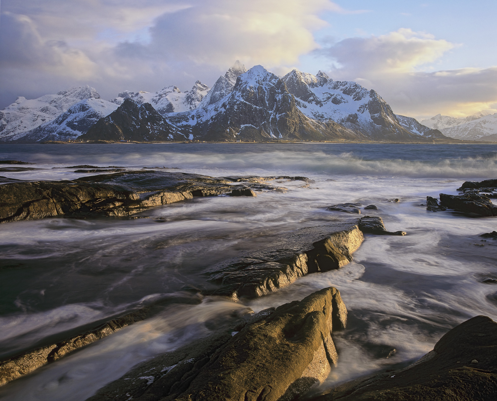 I find that this particular location gazing across the fjord to the icy mountains of Flakstad to be utterly captivating and everytime...