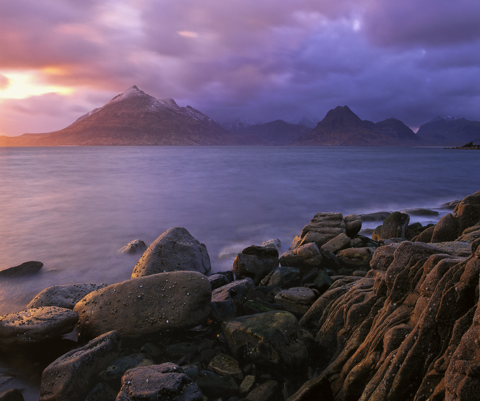 Elgol is a moody place and there is no finer time to photograph it than in light that makes that mood tangible. A setting...