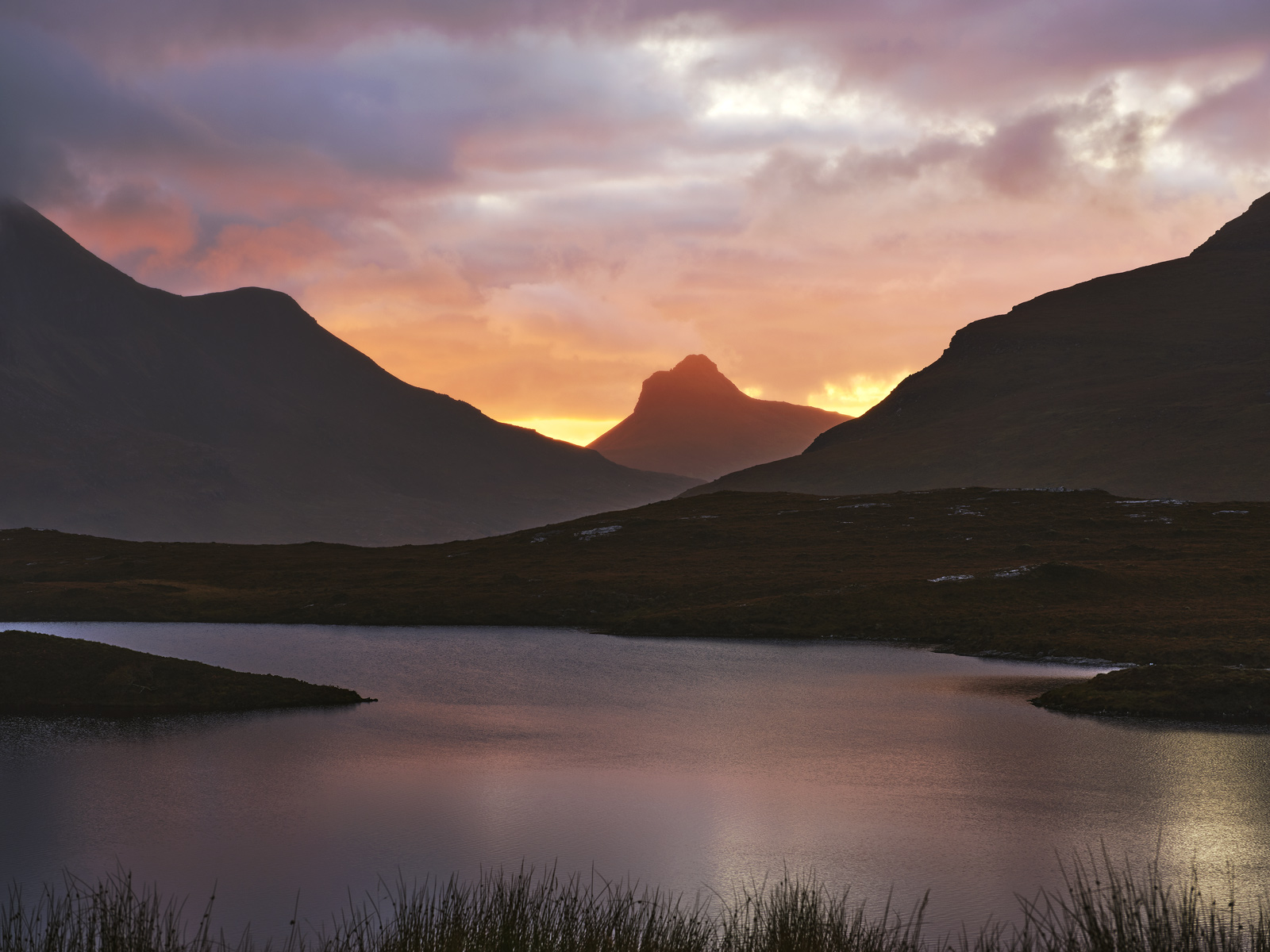 On an incredible evening on my way back home from Sutherland I decided to stop for a sunset break at Knockan Crag and was astonished...