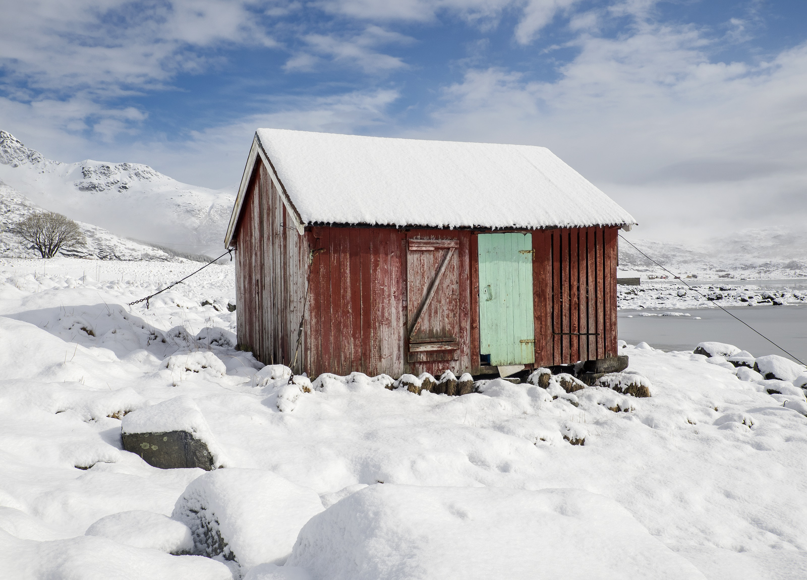 There are many red rorbrua dotted around the Lofoten Islands. These old fishing huts are often converted for use by the...