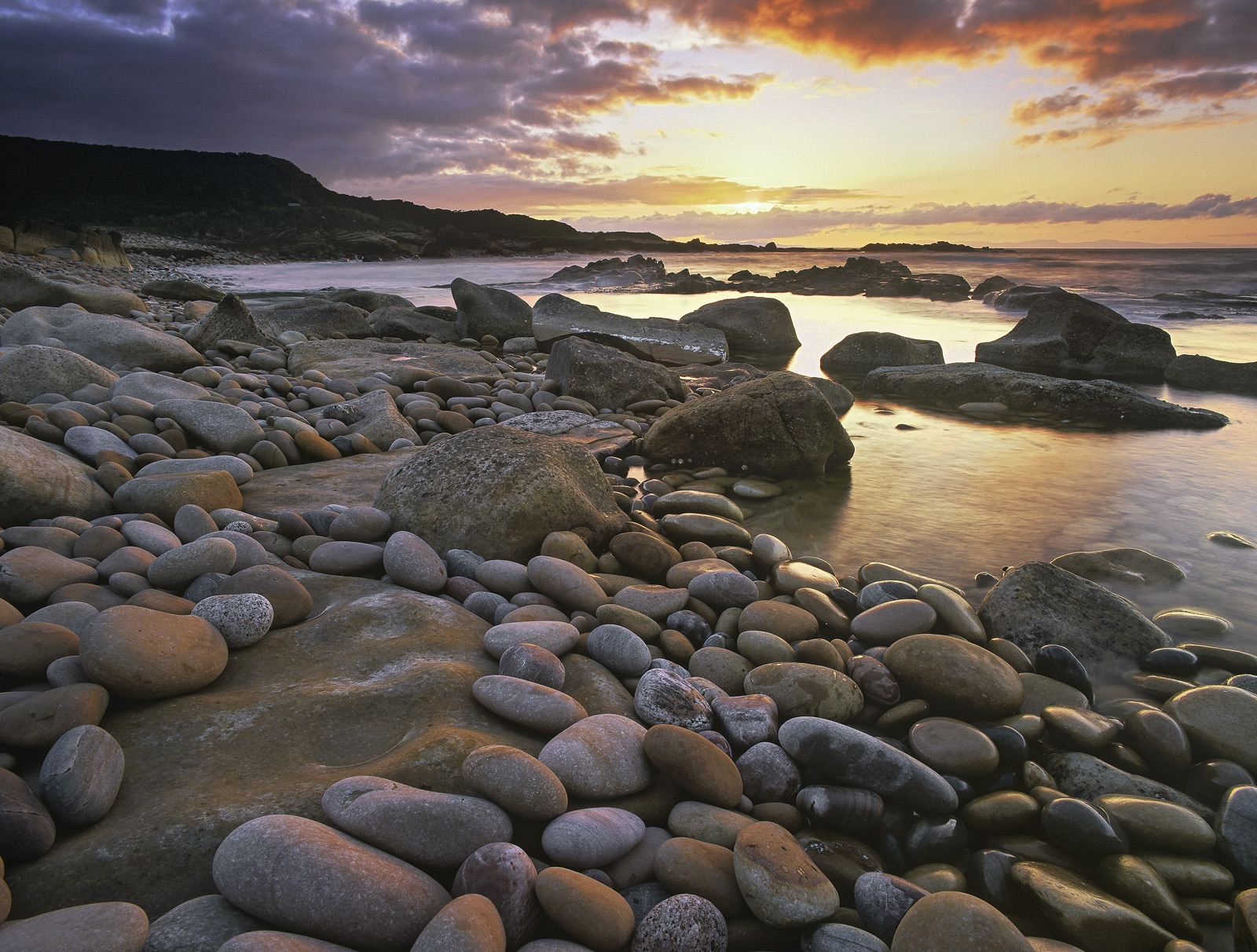 Cove bay is a pebble beach all of which are light in colour and tumble down towards the sea. The pale colouration ensures...