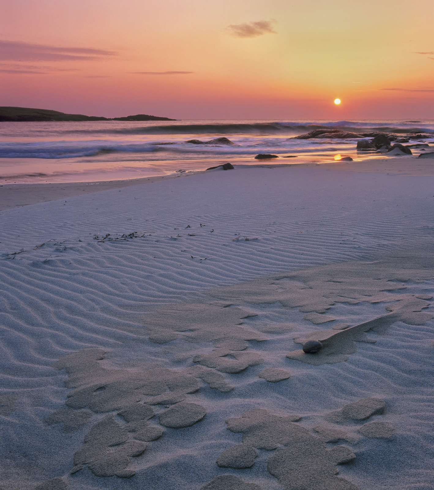 There were a lot of sand sculpted patterns on Hosta beach on this particular evening and with a satsuma sunset starting to develop...