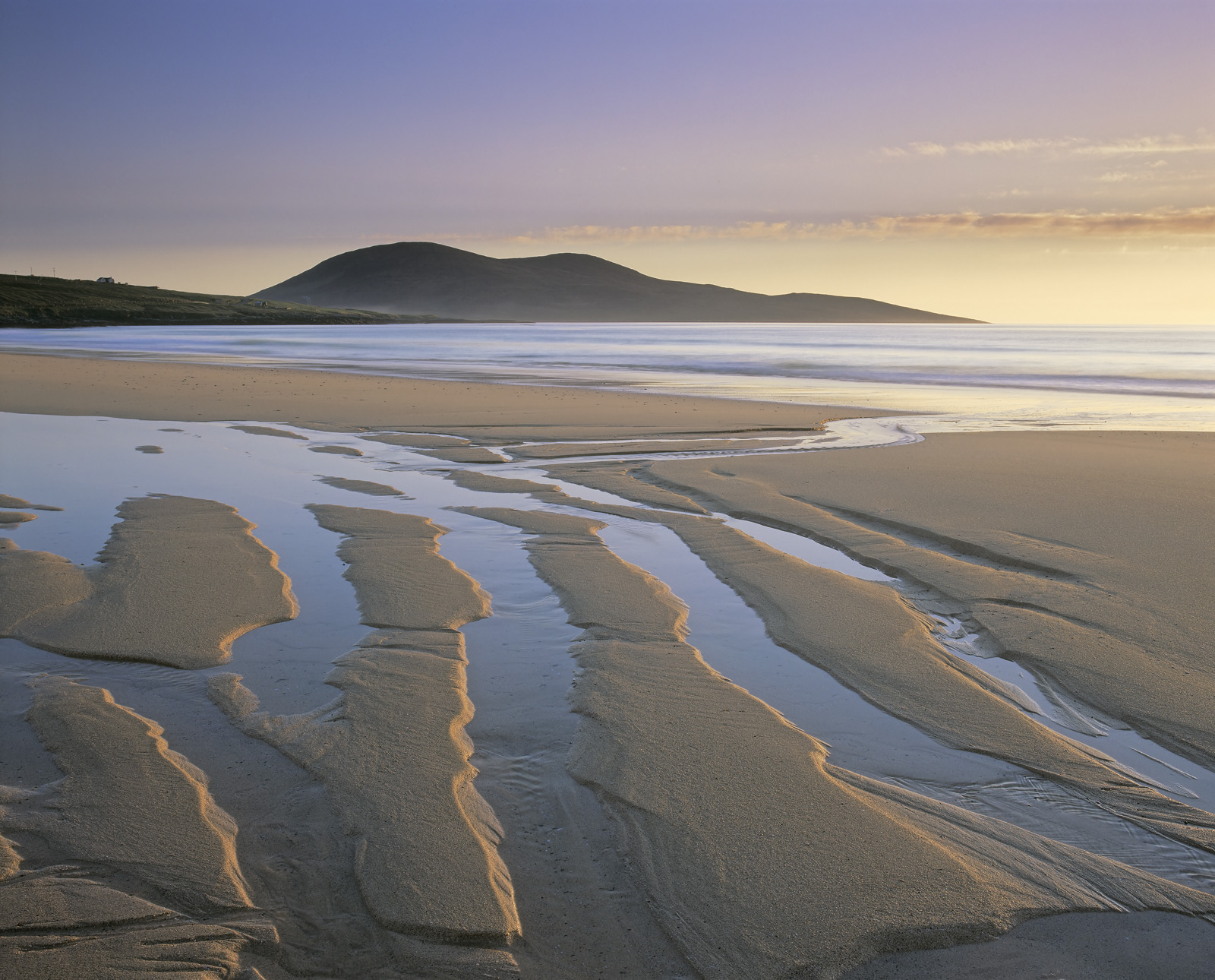 Sand ripples of amazing size and depth are ripped up by the receding tide at Traigh Mhor leaving strong and distinctive patterns...