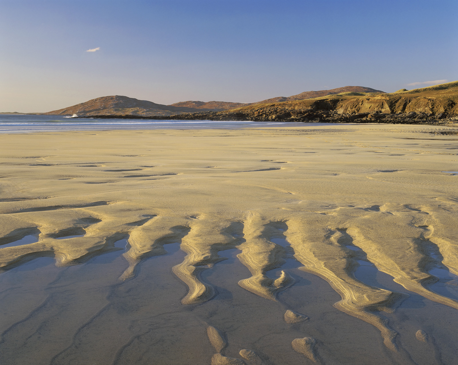 Tongues of golden sand at the edge of a tidal pool strongly characterise this beautiful coarse grained sand beach at Traigh Lar...