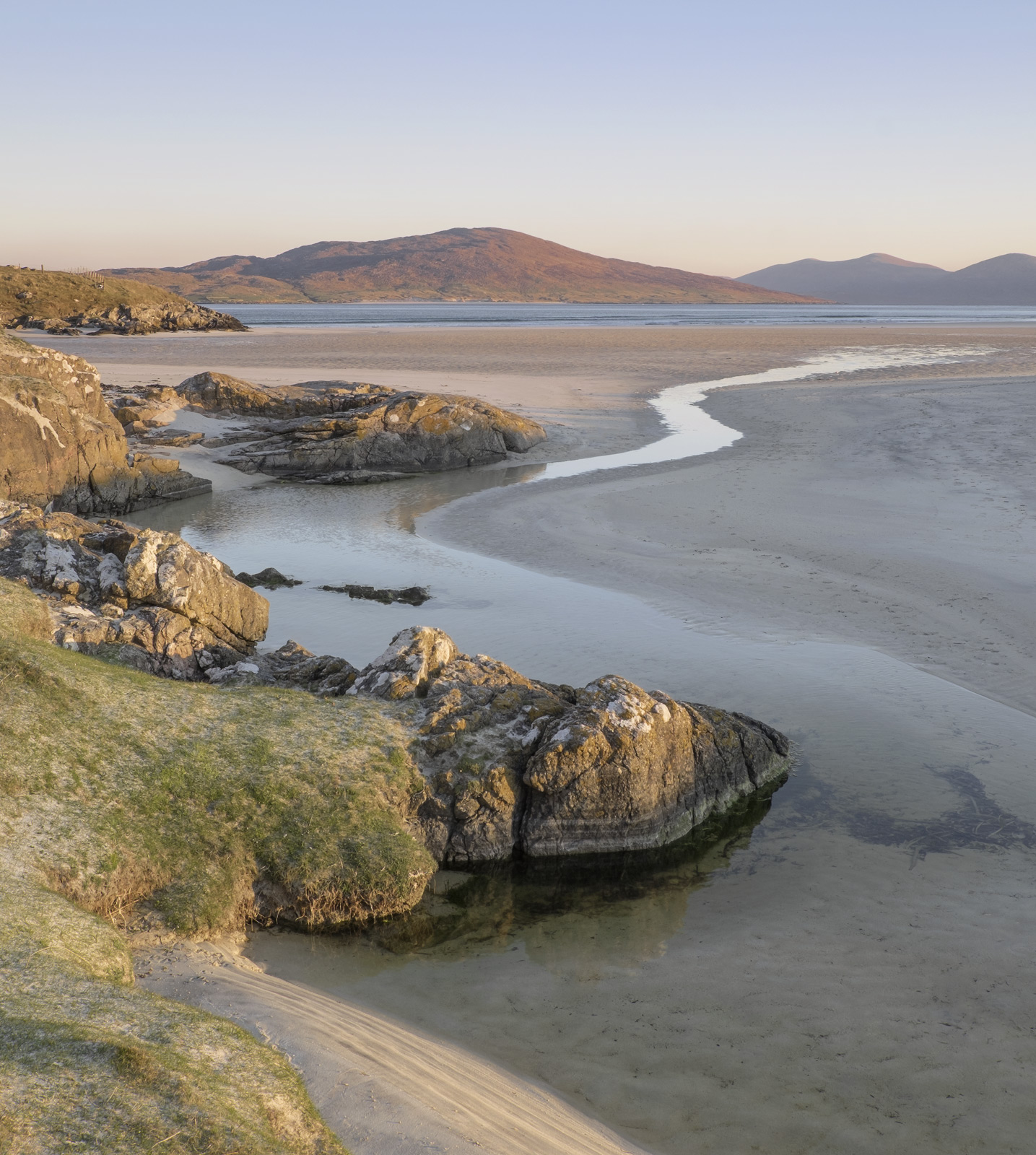 The soft light of a very clear dawn matured slowly over Taransay off the coast of Selebost's vast sandy bay. At one...