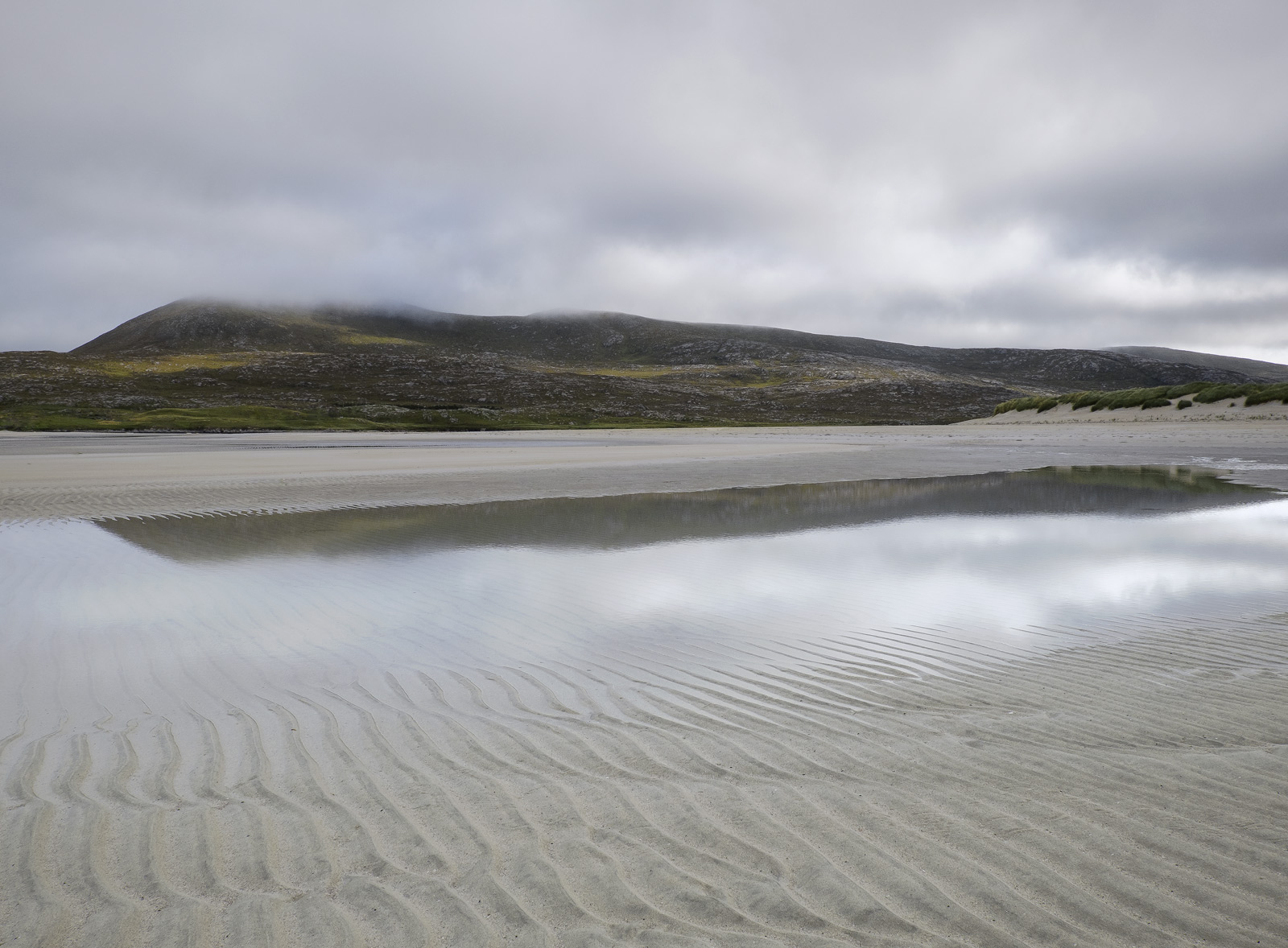 Etched sand patterns and a reflected spit of land across from Seilebost beach on Harris produce a gentle lilting landsacpe of...