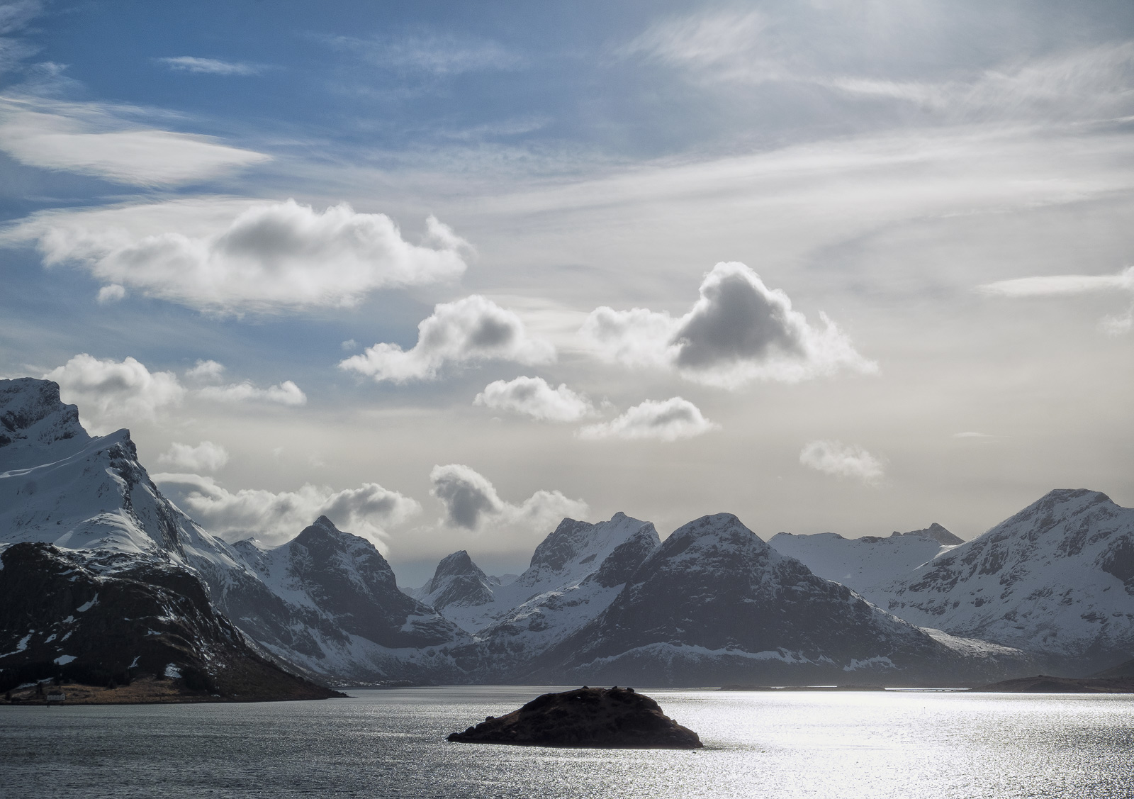 One of my favourite mountain views on the island of Lofoten are these majestic and craggy peaks on the approach to Reine behind...