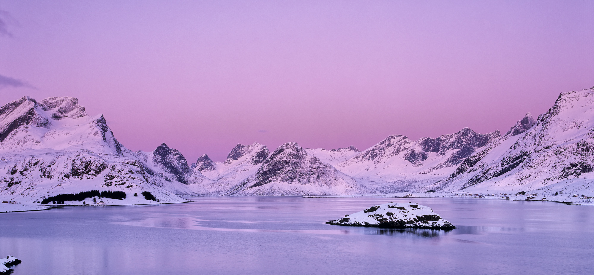 Delicious pink pre-dawn light paints the icing sugar clad peaks of Selfjord turning them the colour of candyfloss whilst the...