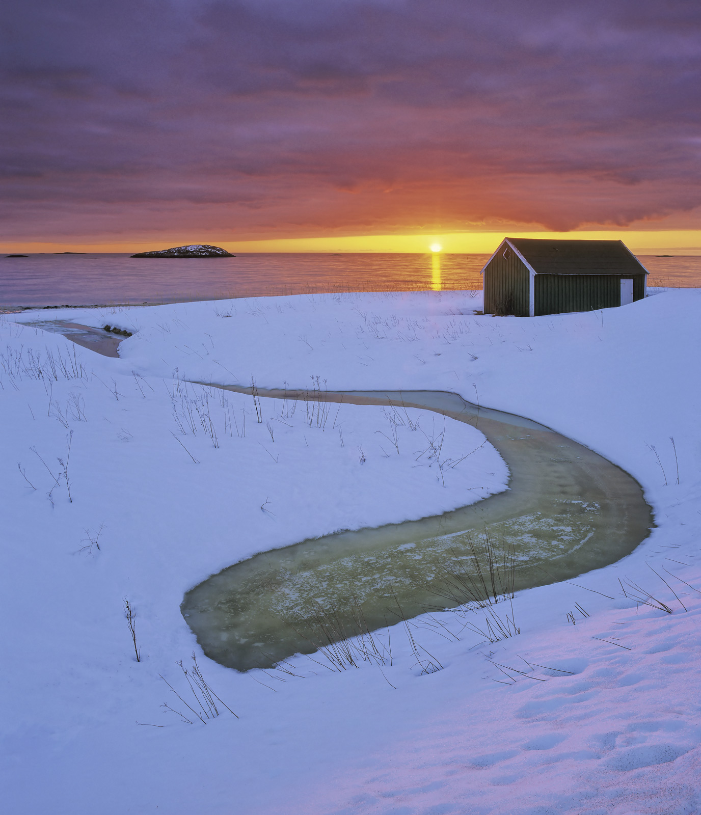 This little beach at the end of Bergsbotn in Senja happens to point in just the right direction for a Spring sunset but of course...