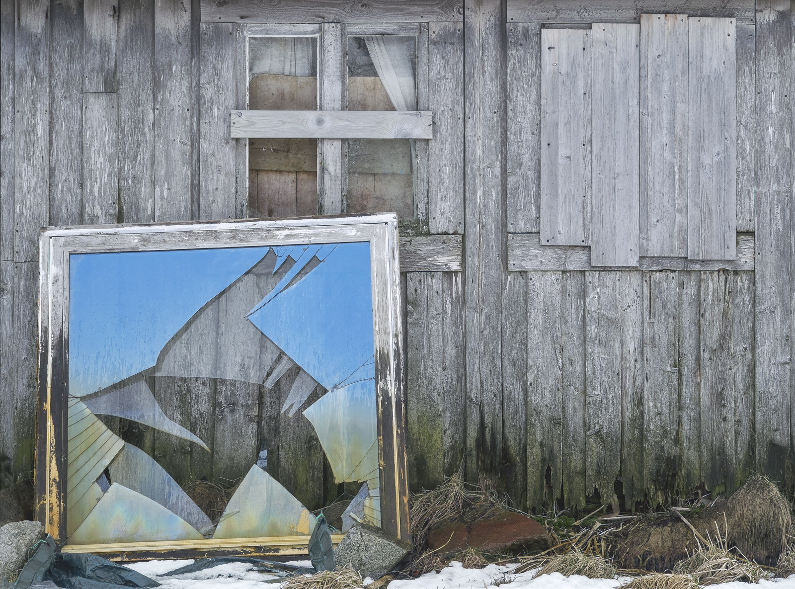 This broken window pane leaning up against the side of an old grey slatted ruined house resonated with me right from the very...