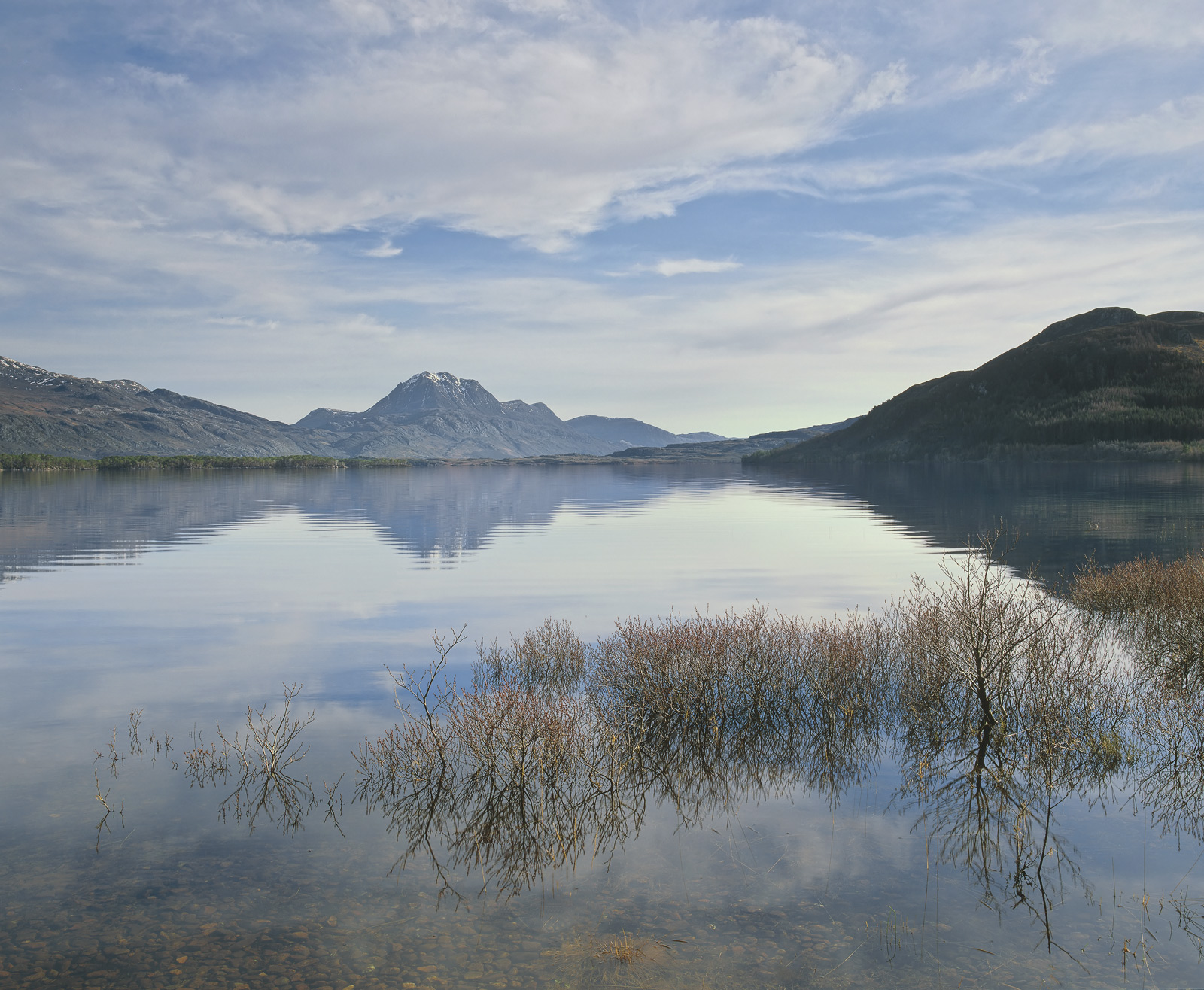 Slattadale is at the western end of Loch Maree and from there you can look across the sheltered bay towards mighty Slioch an...