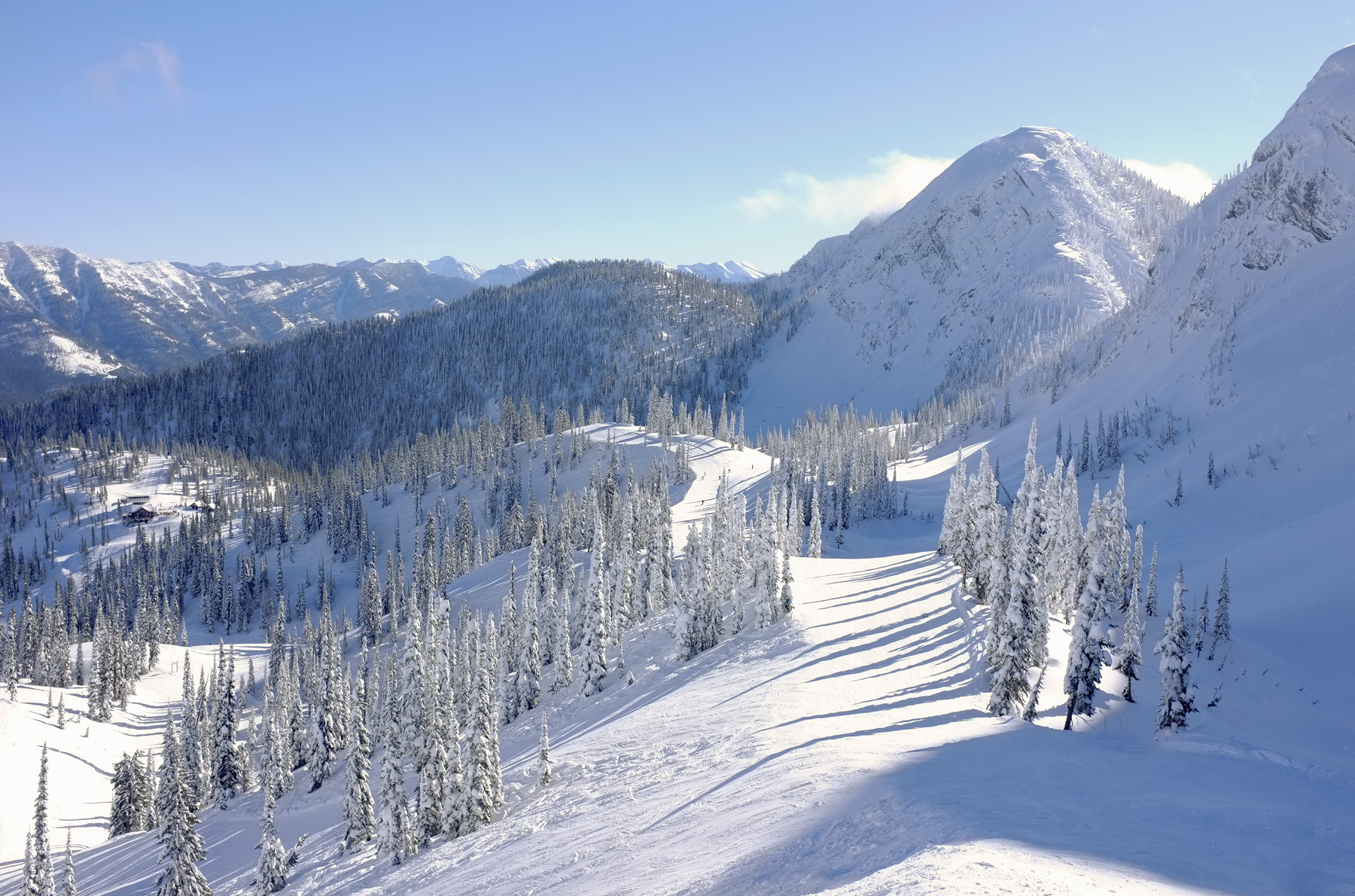A gorgeous mountain view from the top of one of the amazing powder snow bowls at Fernie ski resort. A brief closure of...