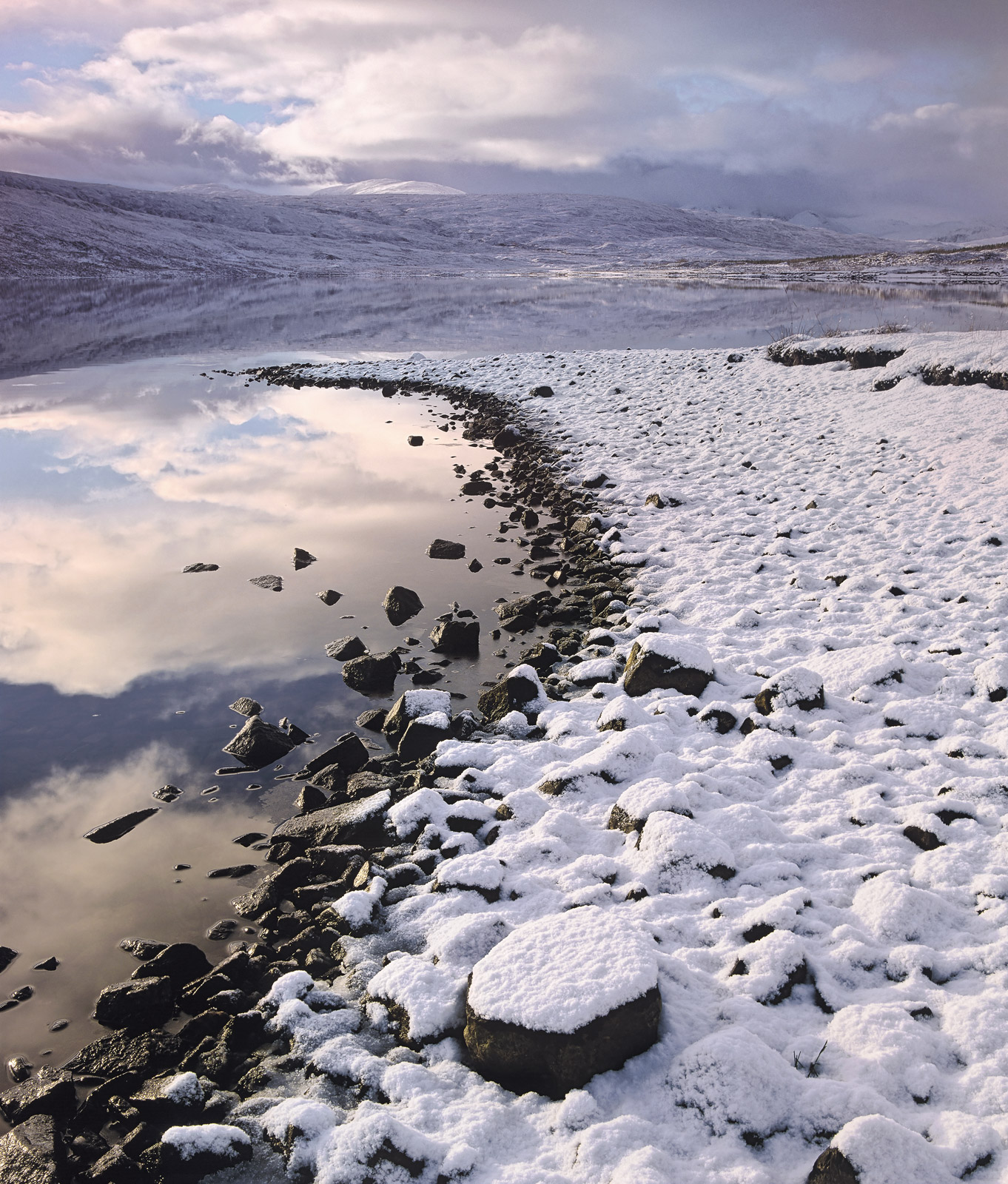 Snow Line 1, Loch a Chroisg, Torridon, Scotland, Achnasheen, Kinlochewe, mirror, flat, snow, dusted, unblemished, tinged, reflected, rising sun, pink, photo