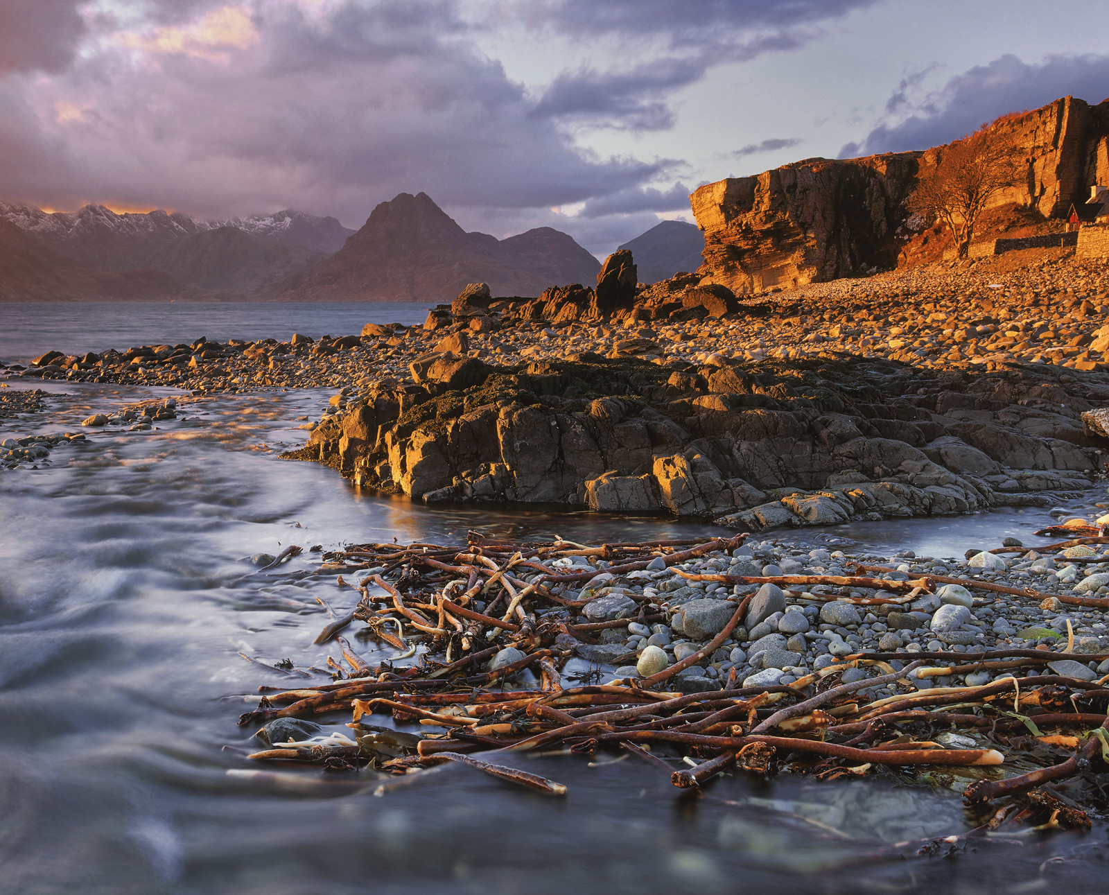 A Spring evening on the beach at Elgol where a small stream bounces over the rough rock beach and meanders into the sea...
