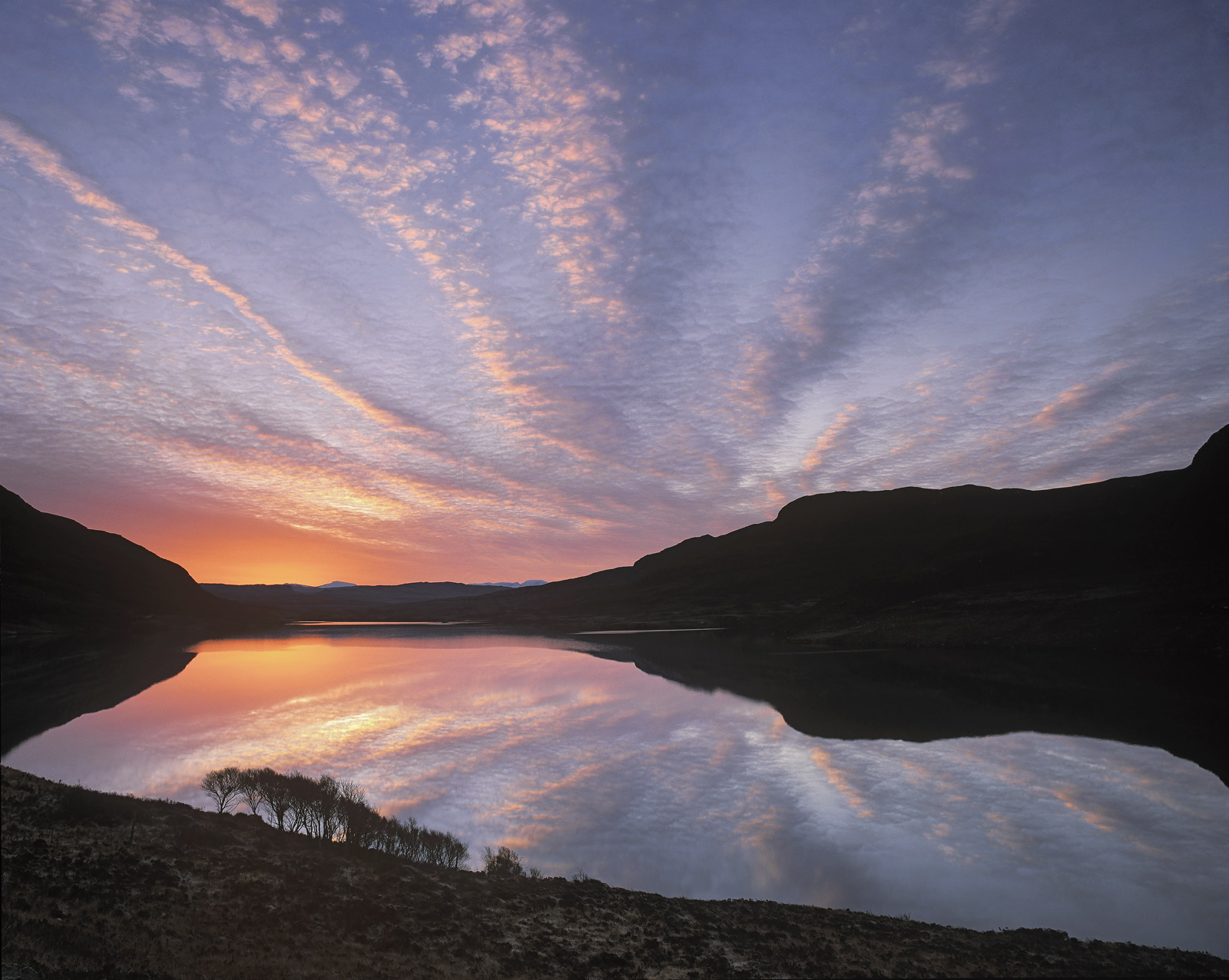 I have never seen a sunrise as dramatic as this one at Inverpolly. I admit at this stage of proceedings it is merely a...