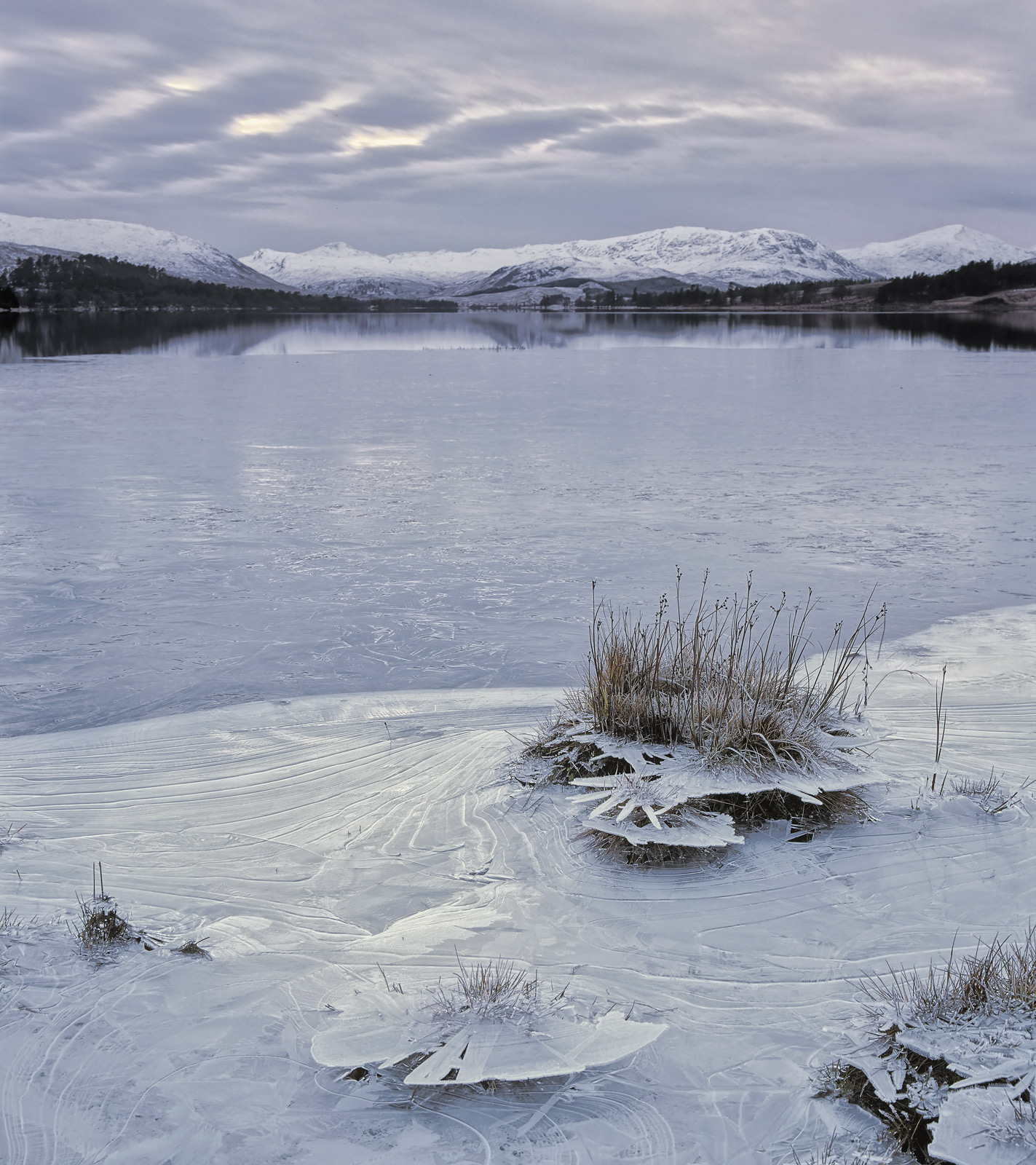 Loch Tulla had completely frozen over almost to the trees on the far side of the loch but clearly the water level had changed...
