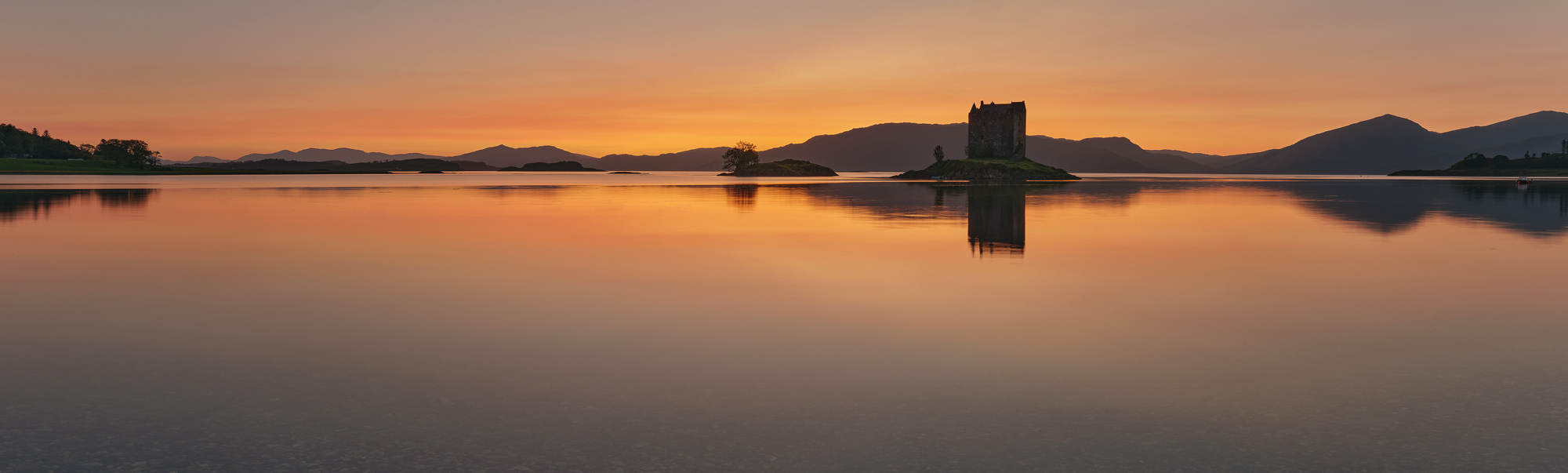I rarely create stitched panoramic images but the extent of this superb sunset across the calm water on Appin Bay on this extremely...