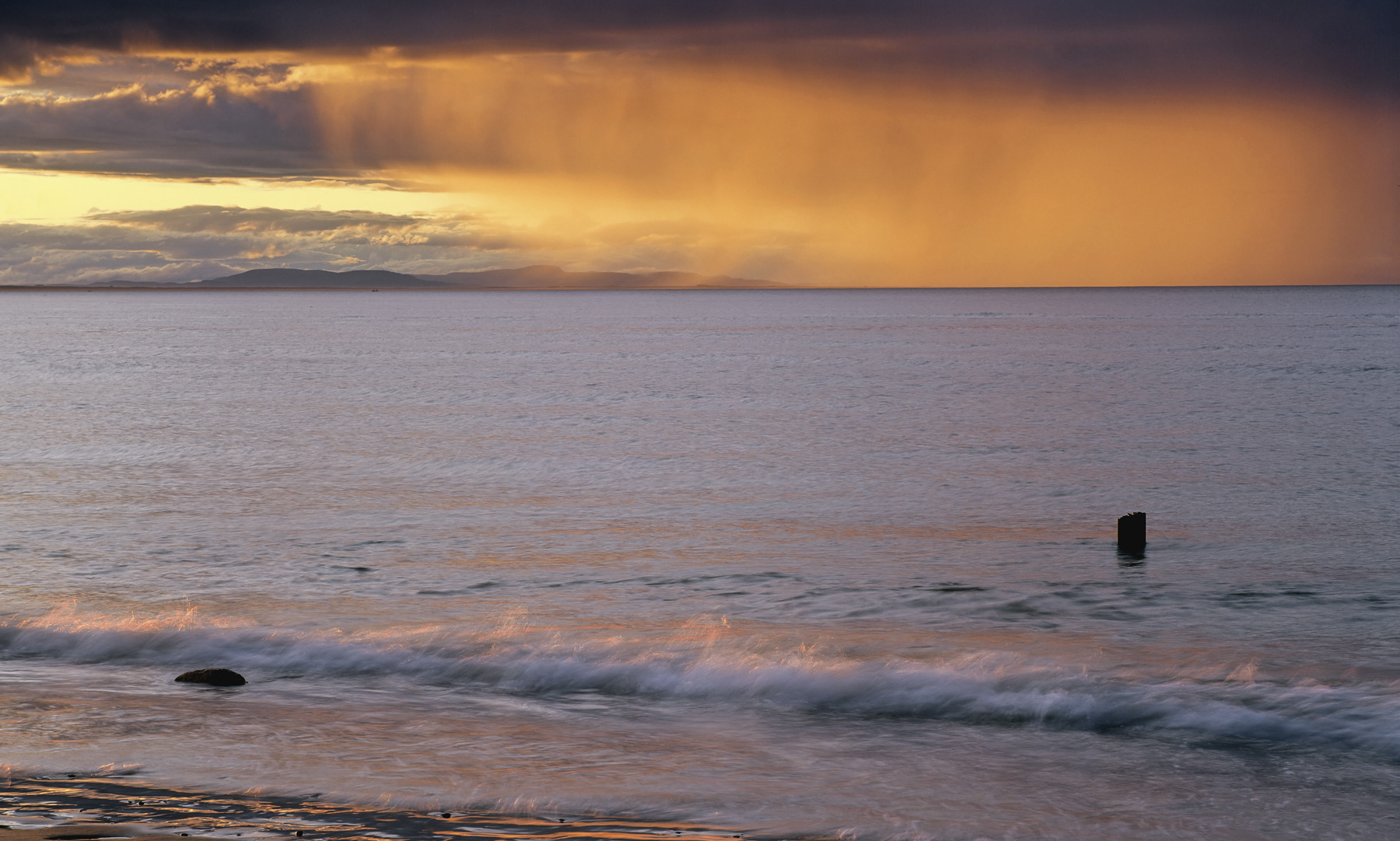 On one of my many wanderings down to Findhorn Bay at sunset I encountered heavy skies with a small break close to the horizon...
