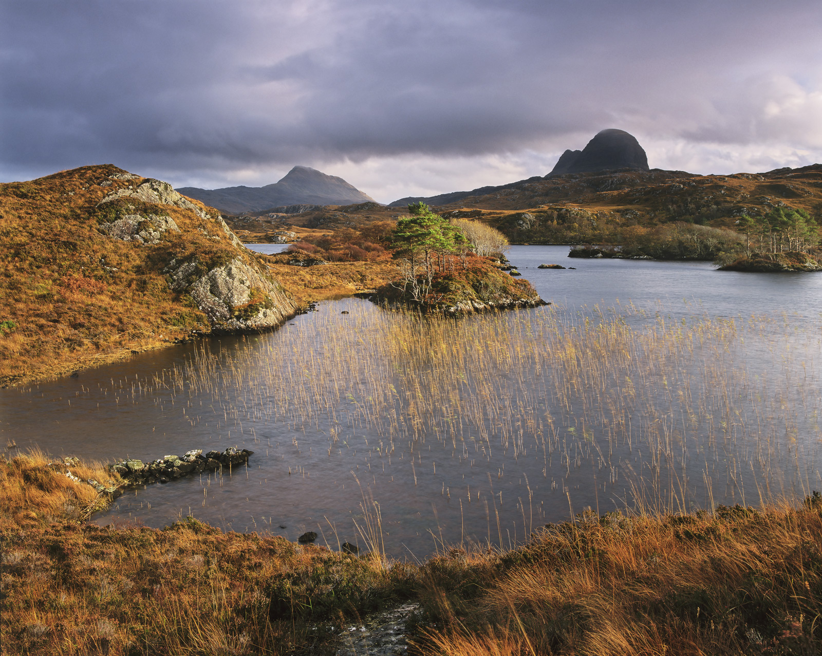 This gorgeous wee lochan is quite well hidden but close to Loch Inver in Assynt. It features both Suilven and Canisp two...