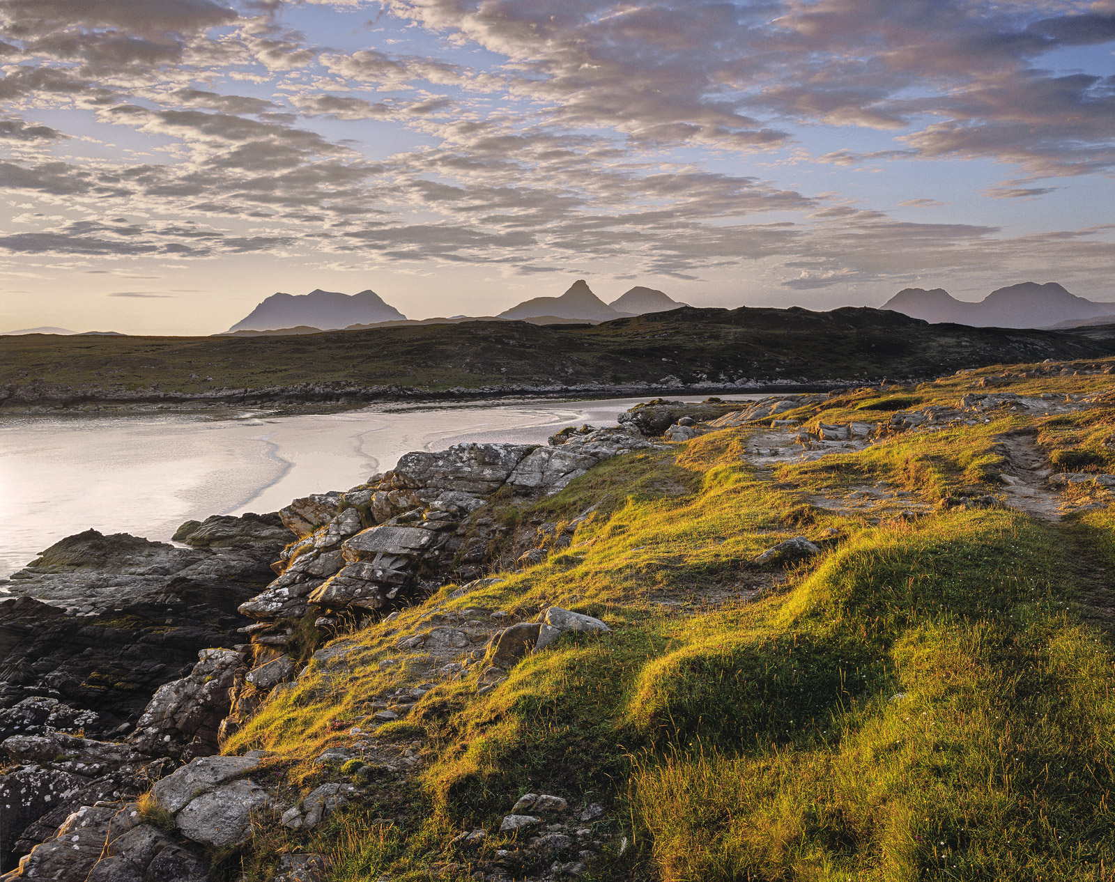 For a brief period there was a camp site located very close to this spectacular view across Achnahaird bay towards the instantly...