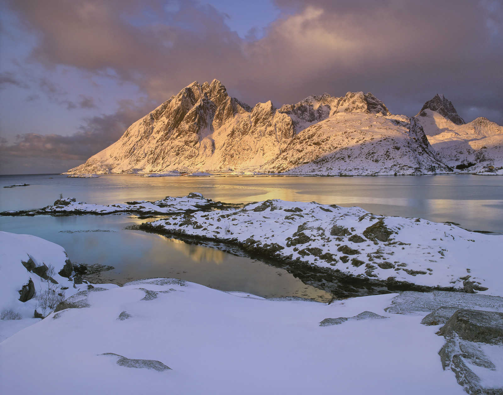 One of my personal favourite viewpoints on Lofoten. The view across the fjord towards the peaks surrounding Reine is at...