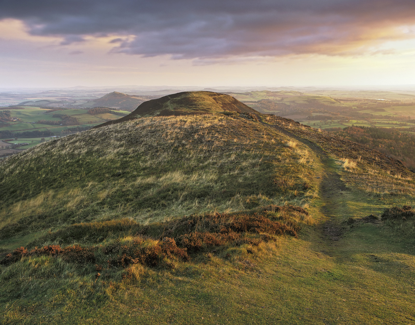 The softest wash of golden sunlight flickered across the tops of the Eildon Hills near the town of Melrose in the Scottish Borders...