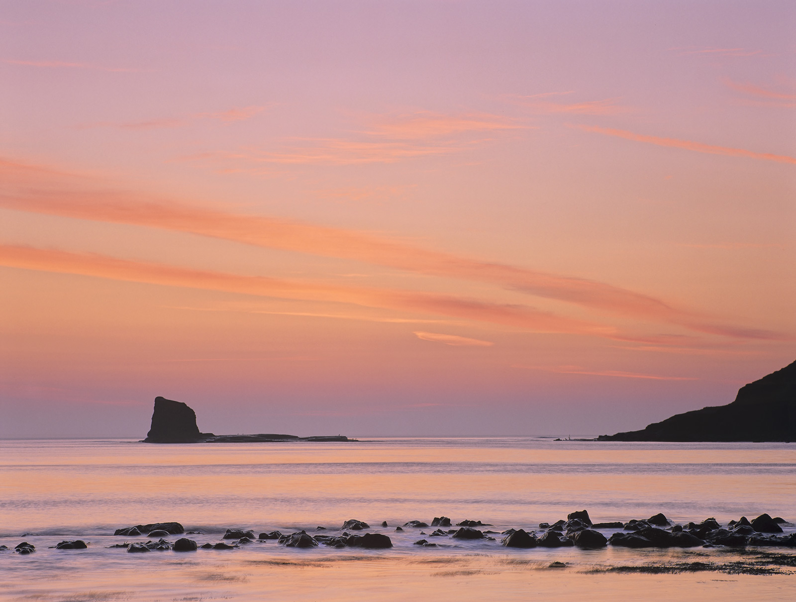A gorgeous tangerine sunrise matured over Saltwick Bay and the Nab during a brief trip to England. I liked the cloud lines...
