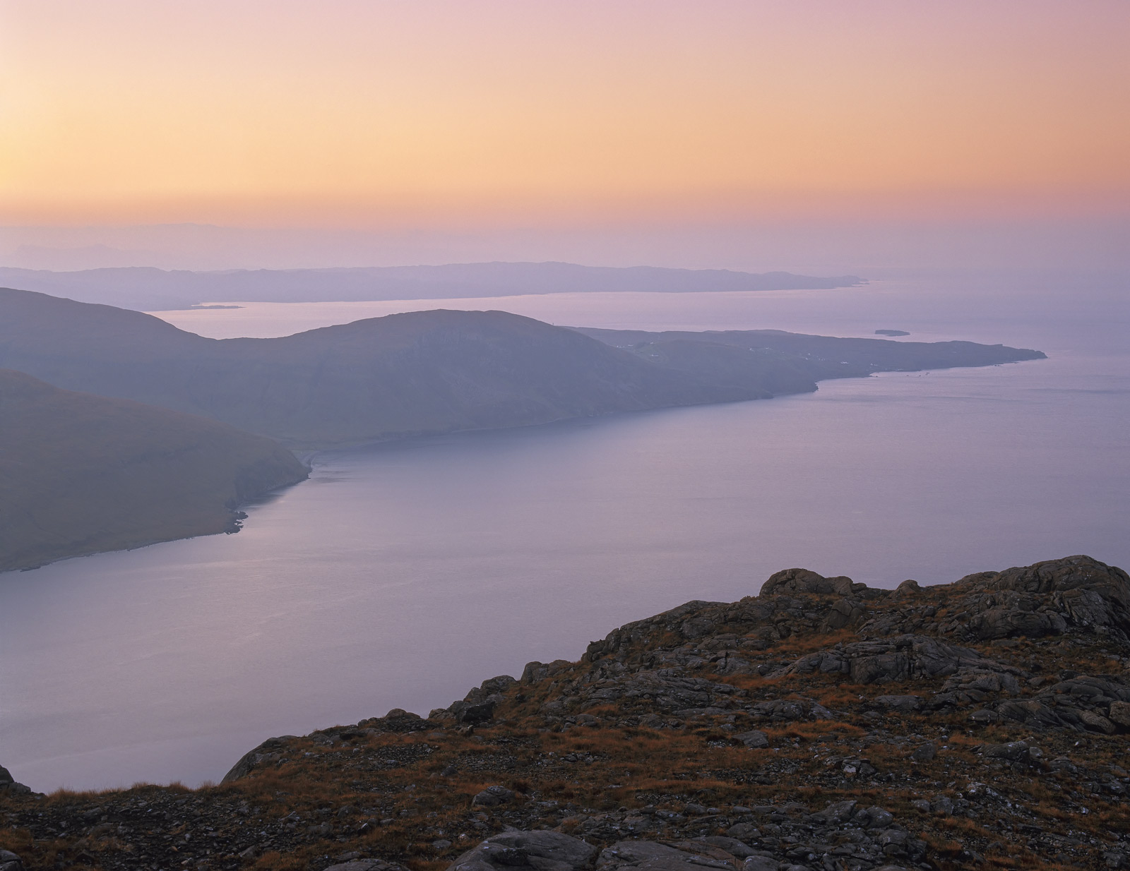 A supreme moment of tranquility just prior to sunrise from the top of Sgurr Na Str on Skye. The previous night had been...