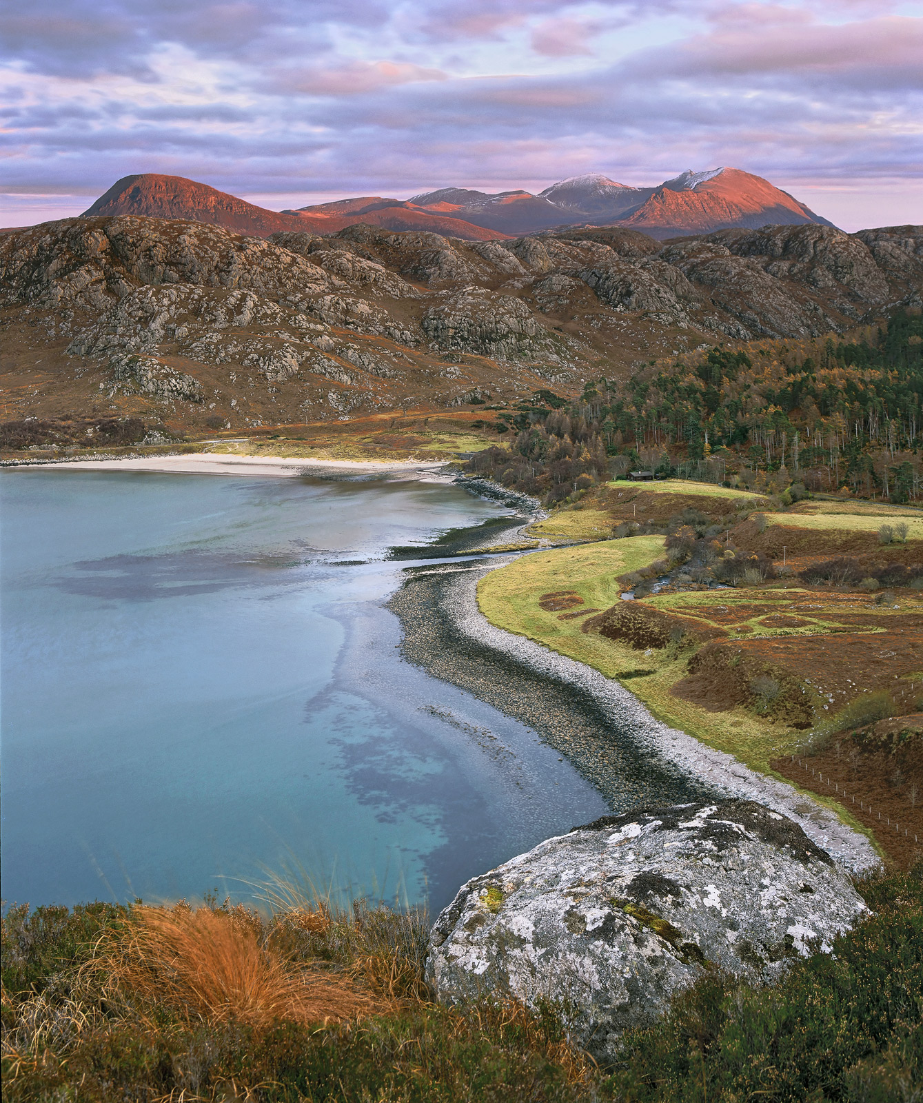 The viewpoint over the second coast at Gruinard Bay is a popular stop for tourists who love the mountain view with the turquoise...