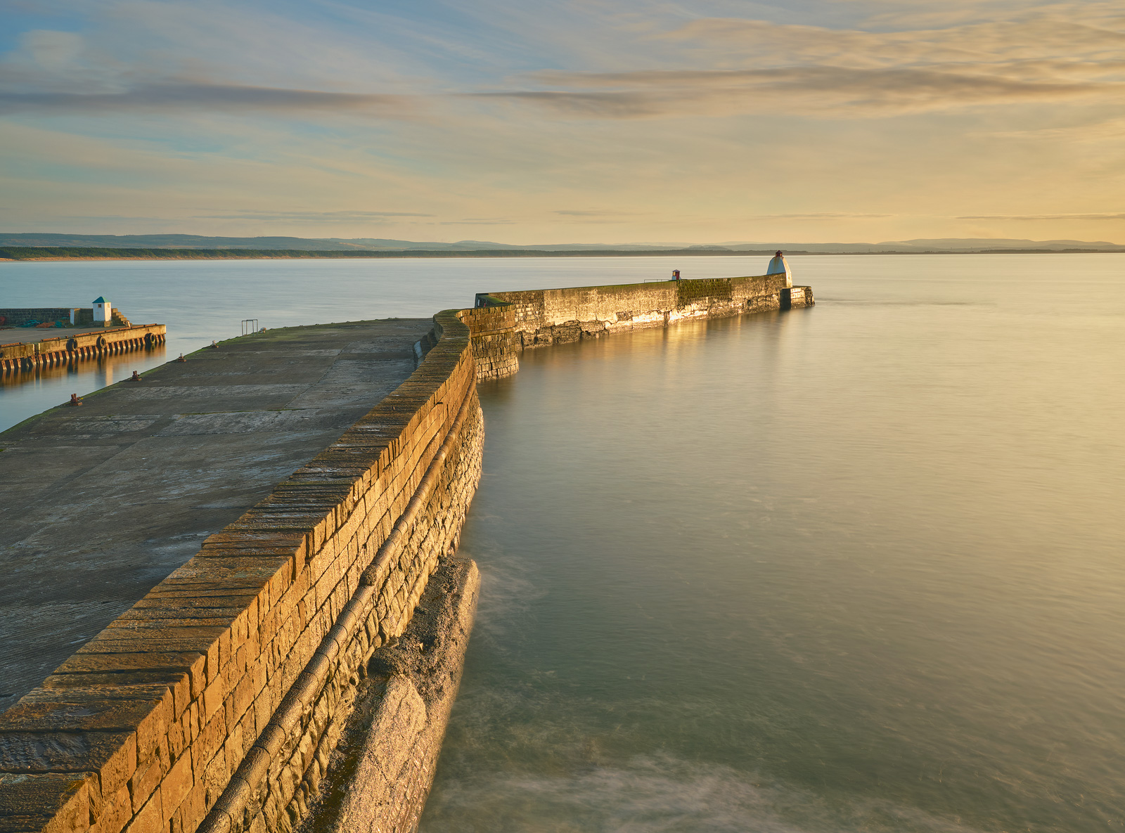 This was the first of the winter evening sunset shots I took overlooking Burghead harbour from a rocky podium with the golden...