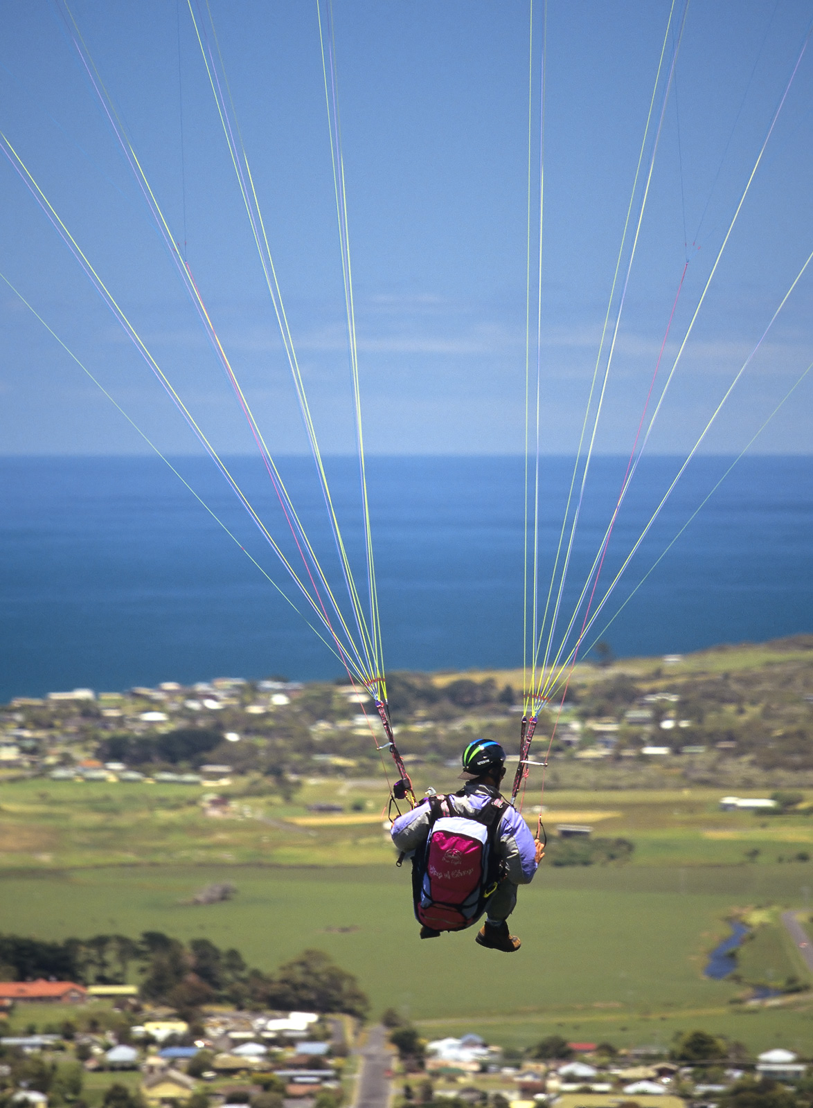 Travelling along the Great Ocean Road we noticed several paragliders launching themselves off the cliffs at Marineo above Apollo...