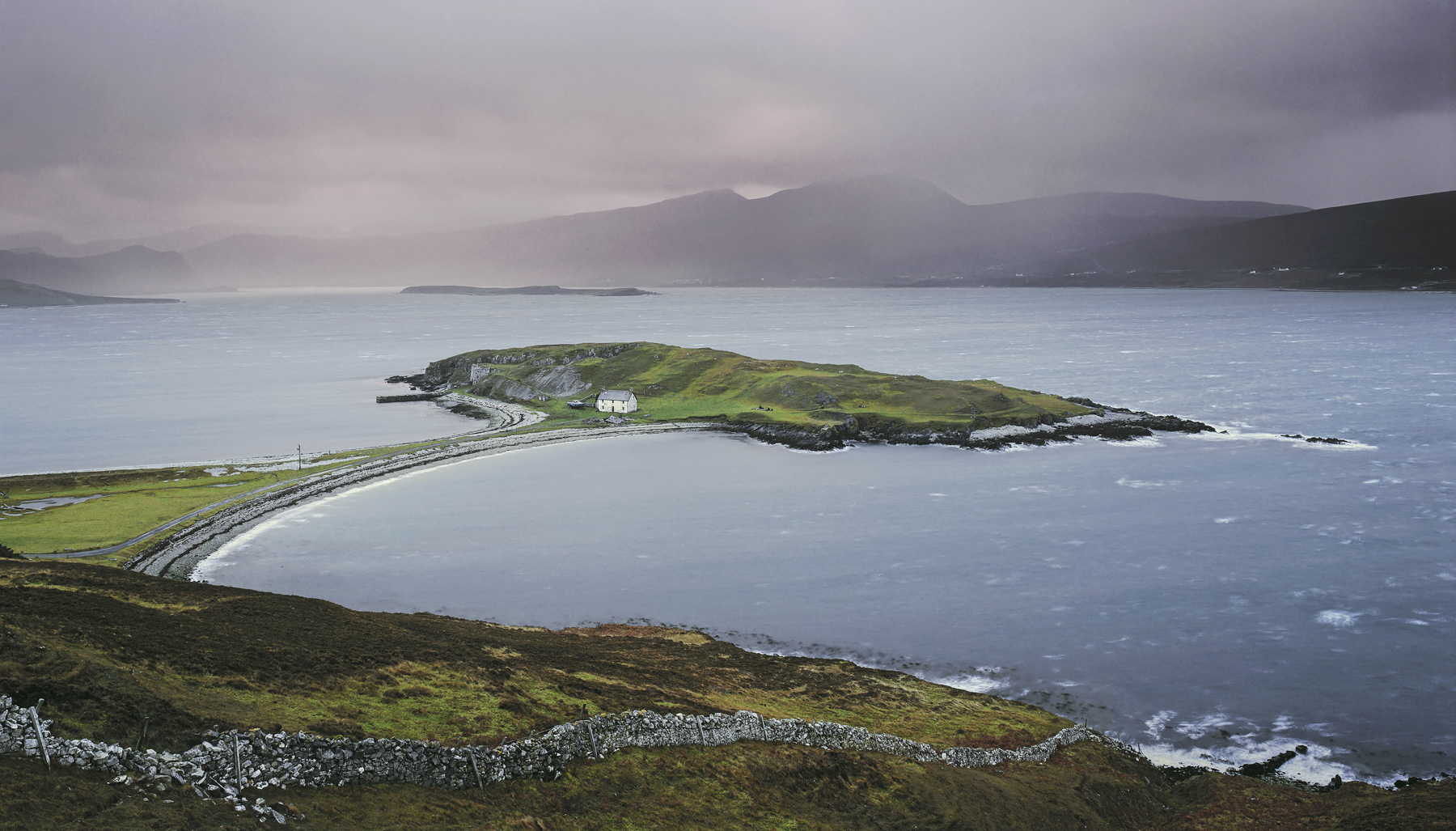 Loch Eribol is a vast salt water loch that happens to contain one very unusual feature. A tombolo is a spit of land connected...