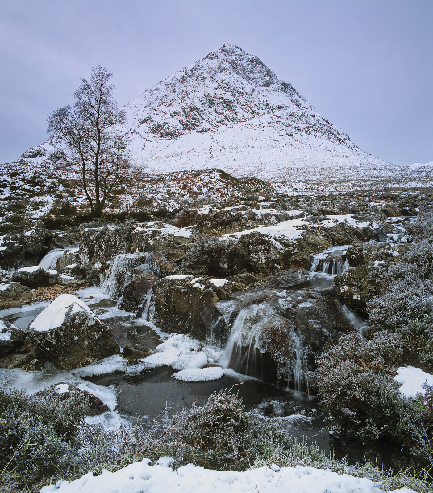 The looming pyramid of the Buachaille Etive Mor Lords it over the desolation of Rannoch moor on a freezing cold and sombre winter...