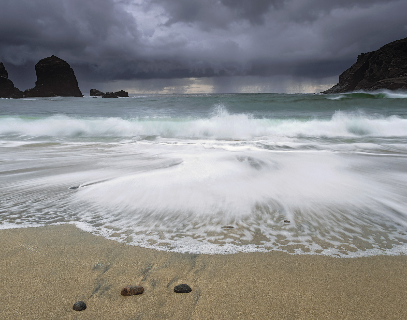 A storm seemed to be raging out to sea on the west coast of the Isle of Lewis and huge breakers were being forced into the cove...