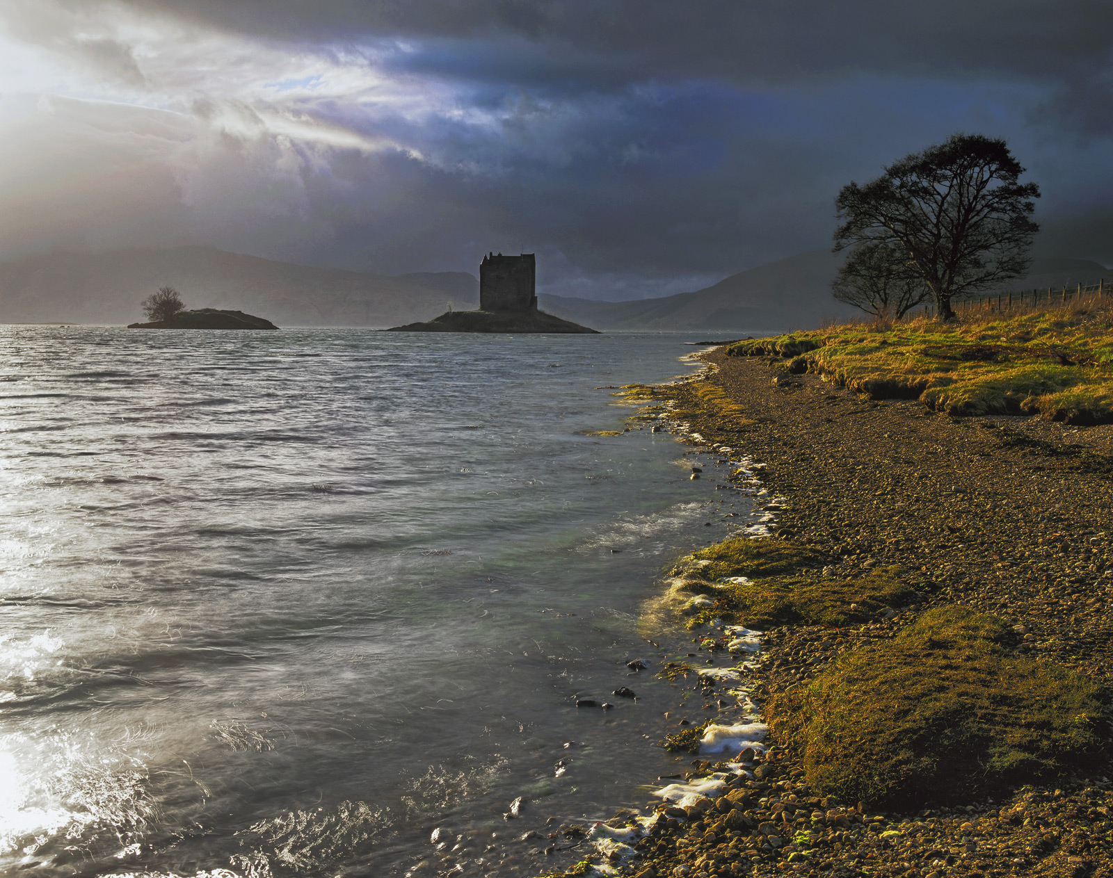 Wind and light screamed in below base clouds lighting the castle, the trees and the immediate foreshore with intense butter coloured...