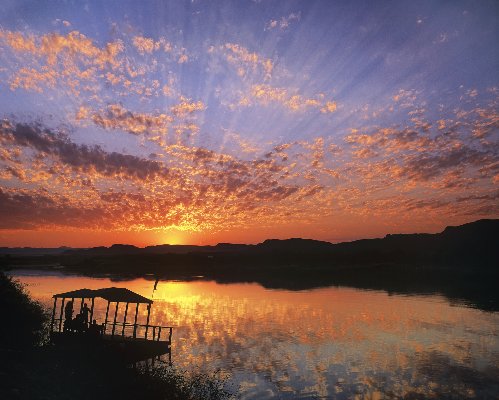 Under African Skies, Orange River, South Africa, Africa, Namibia, evening, sunset, silhouetted, pontoon, campsite, photo